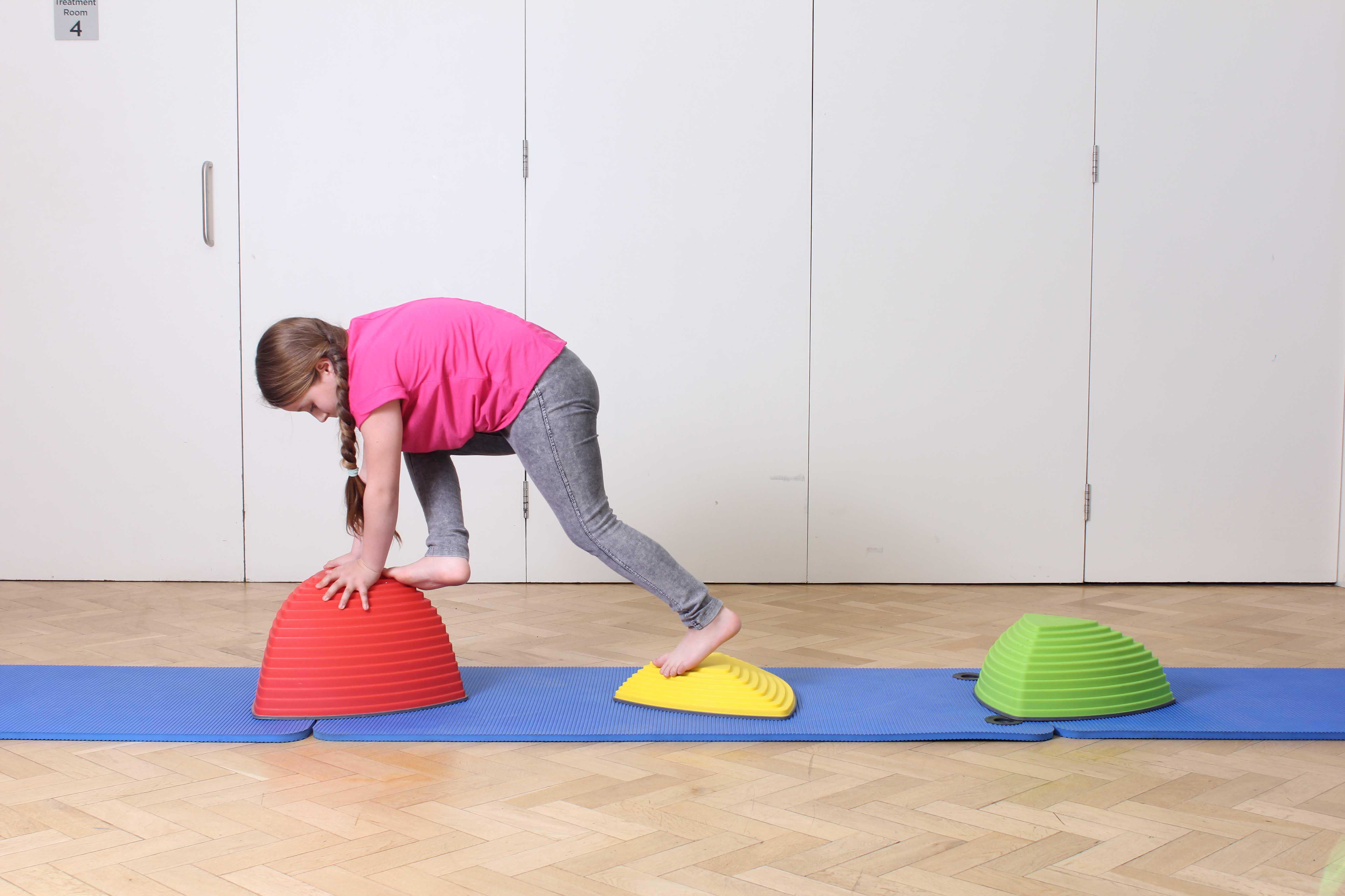 Toning and strengthening exercises assisted by specilaist paediatric physiotherapist