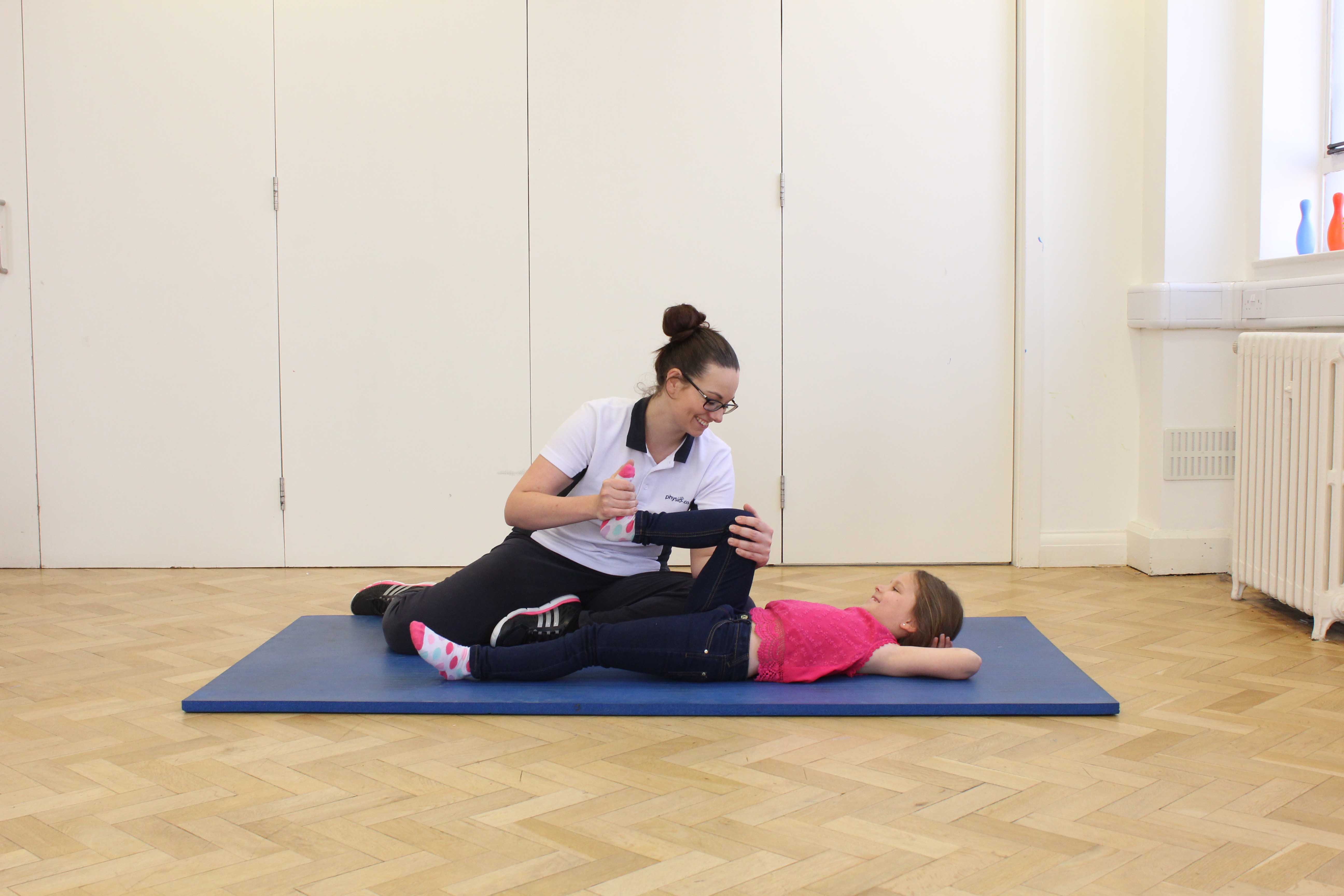 Upper limb mobility and co-ordination exercises assisted by a paediatric physiotherapist