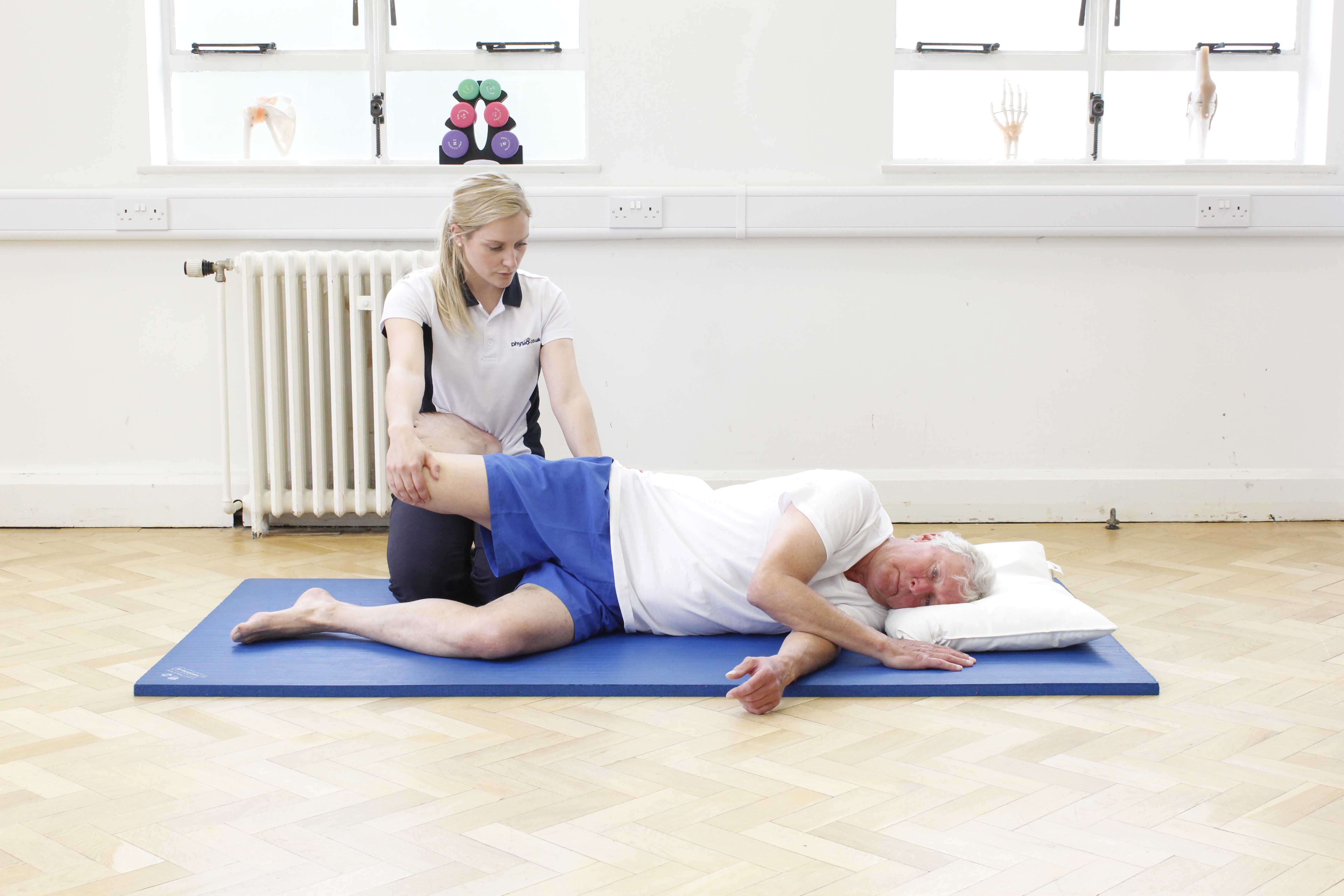 Stertches and mobilisations of the hip and knee joint to relieve pain and lower muscle tone