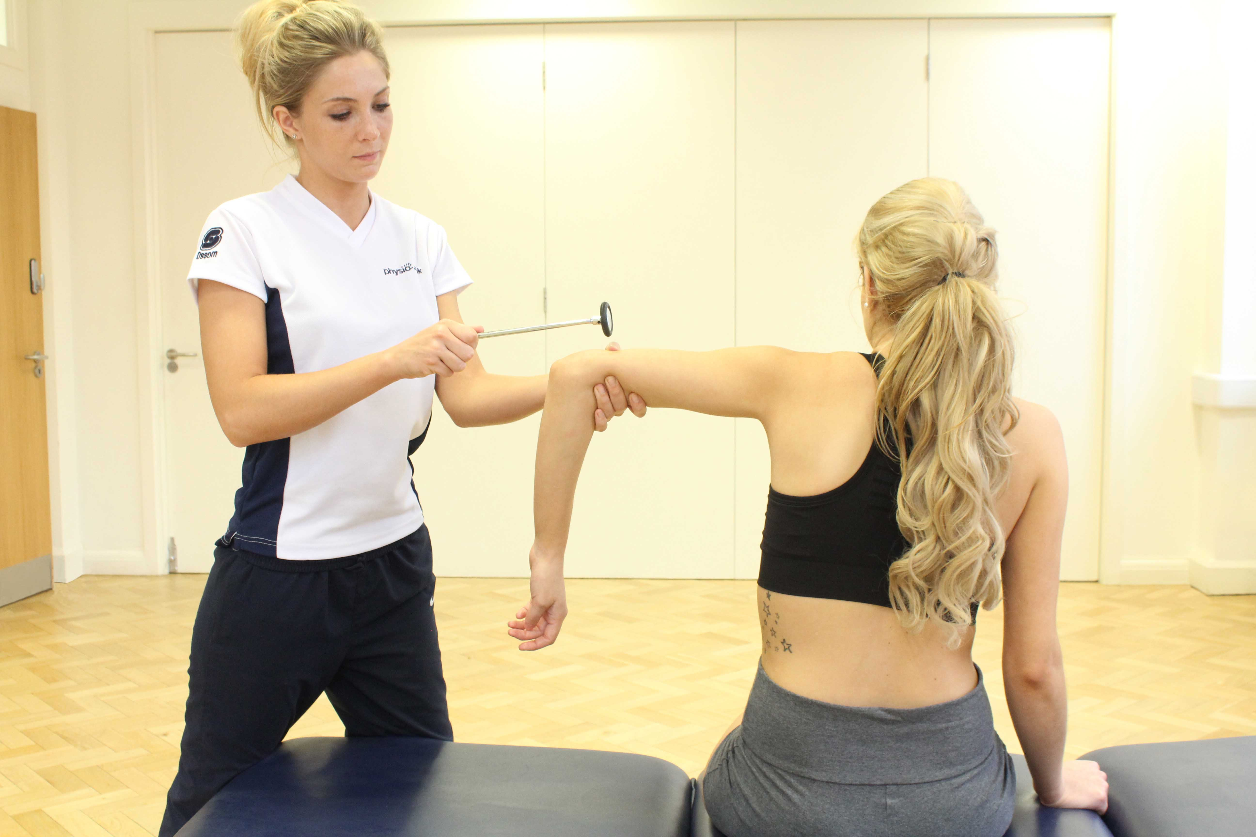 Transverse friction massage applied to the connective tissue around the elbow