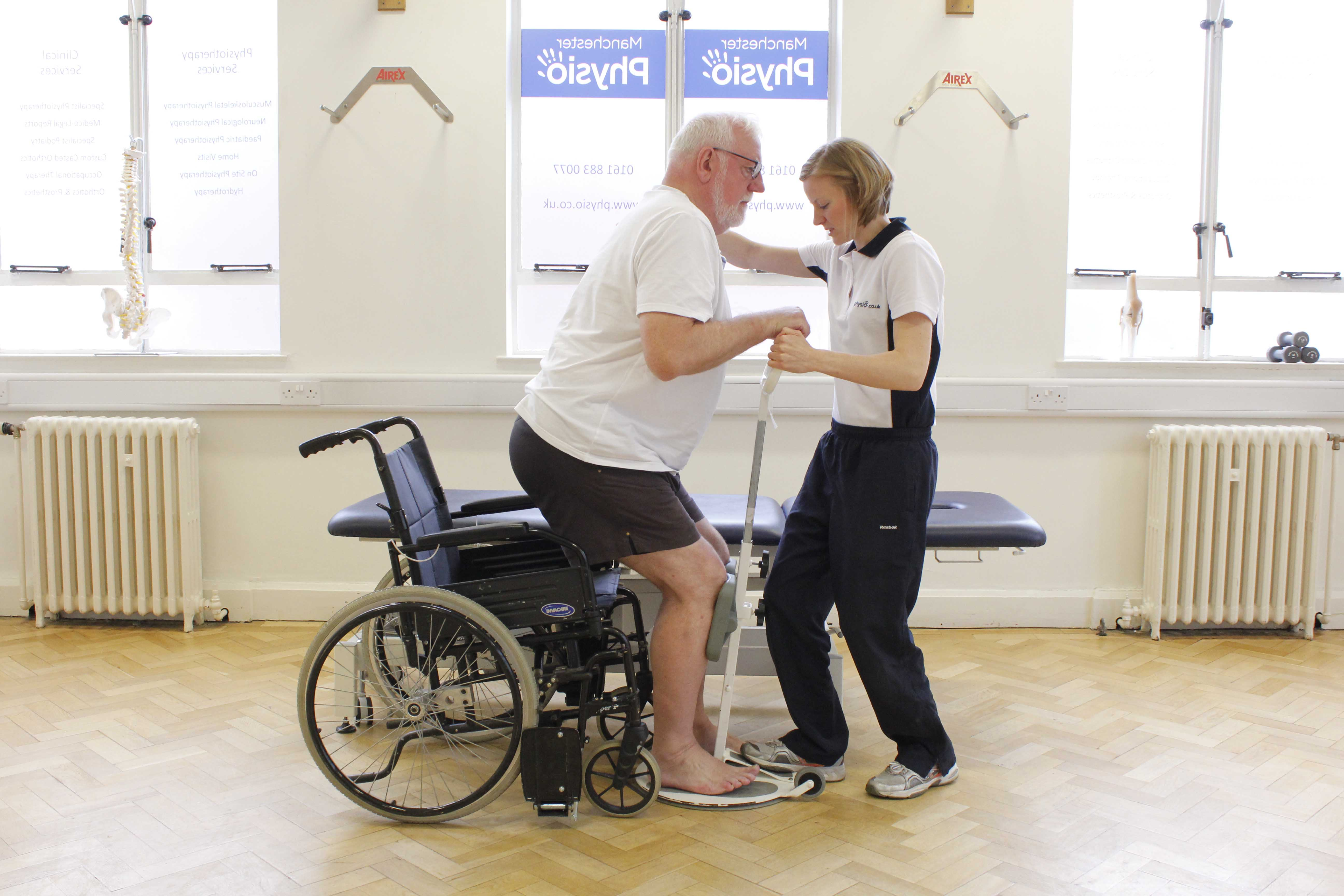 Practice of transfers with assistance of specialist physiotherapist
