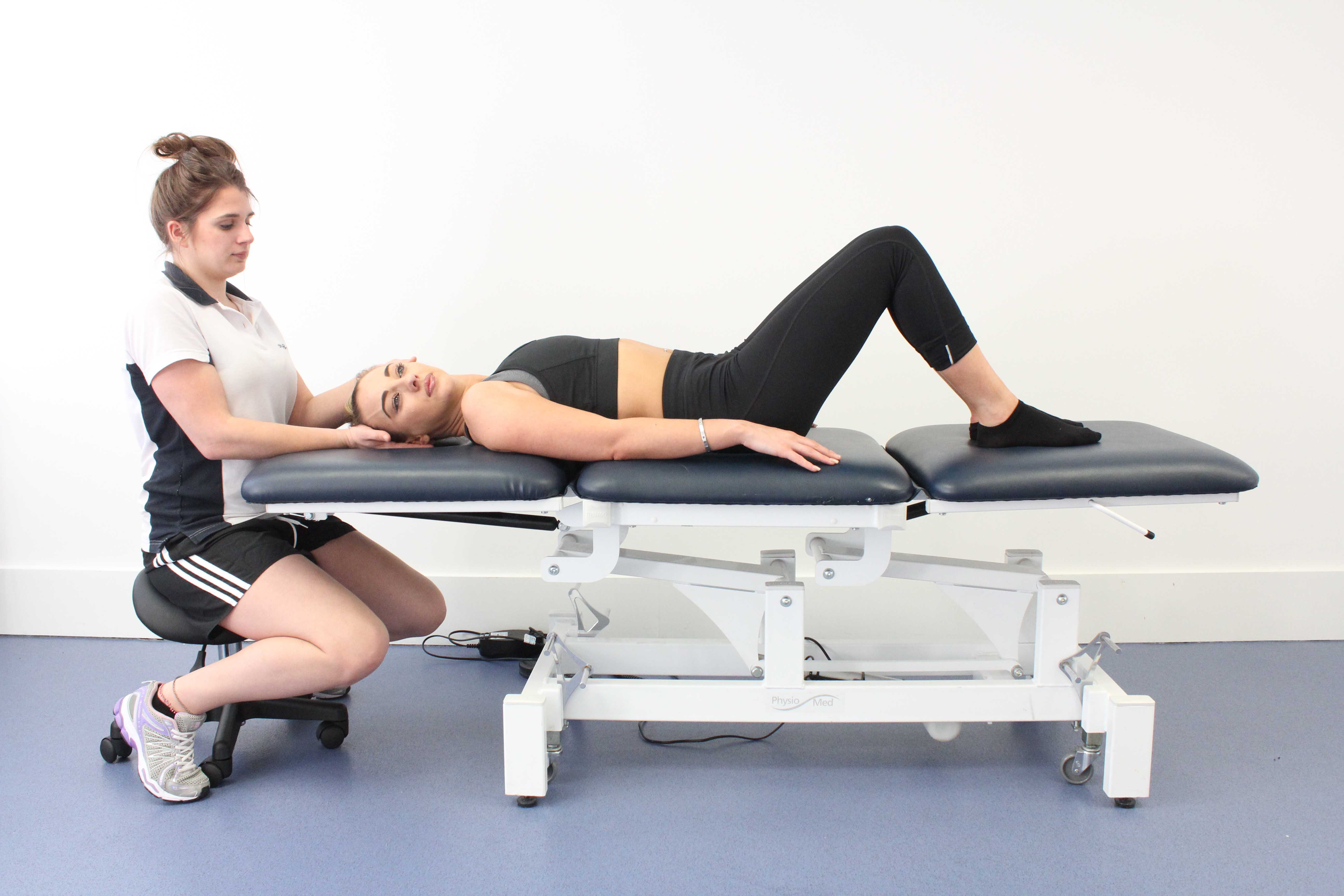 Specilaist physiotherapist performing the Eply manoeuvre to provide vestibular rehabilitation