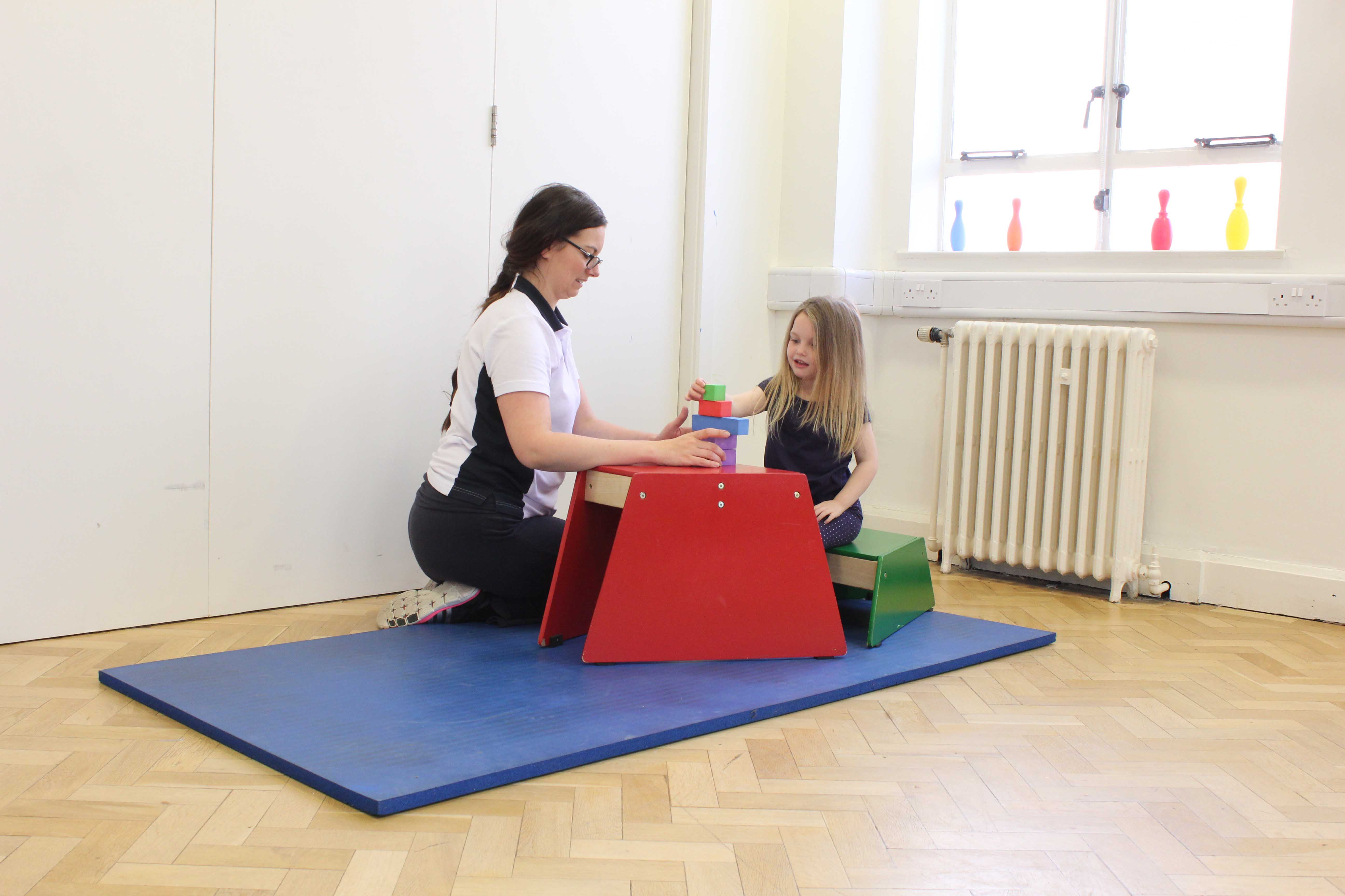 Fine motor skill rehabilitation for the upper limb assisted by a specialist paediatric physiotherapist