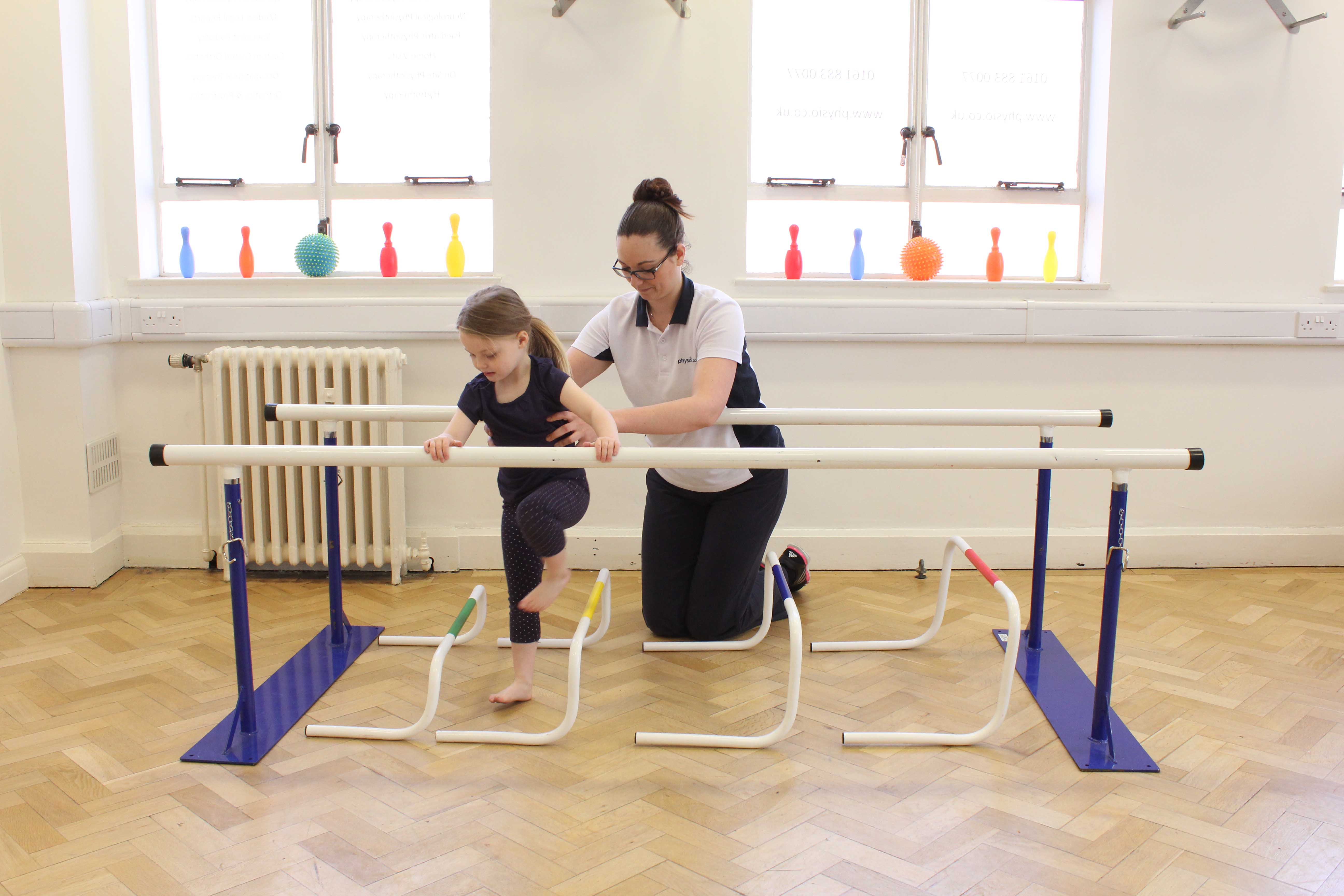 Exaggerated side stepping exercie between parrallel bars with therapist supervision.