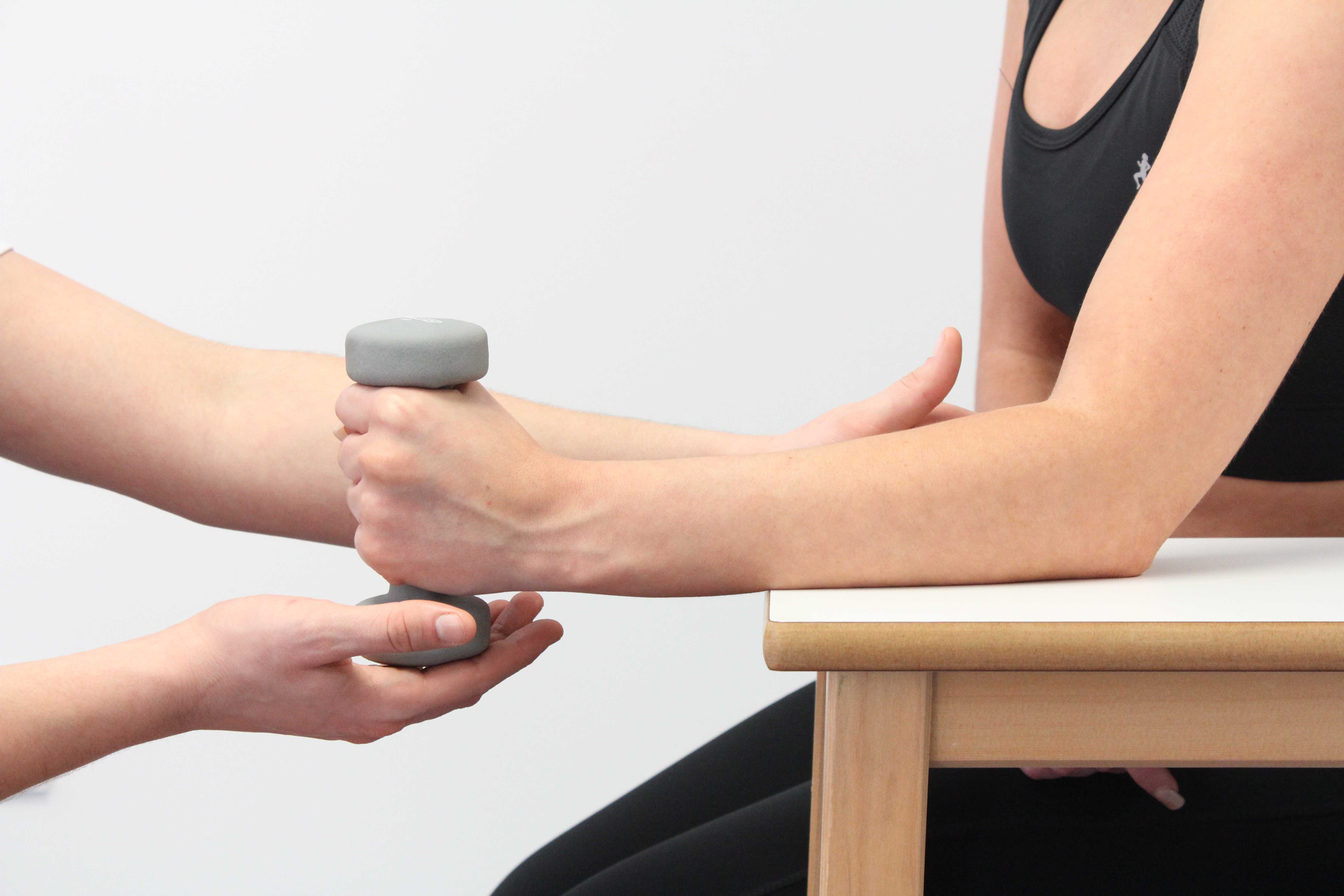 Progressive wrist strengthening exercises supervised by physiotherapist