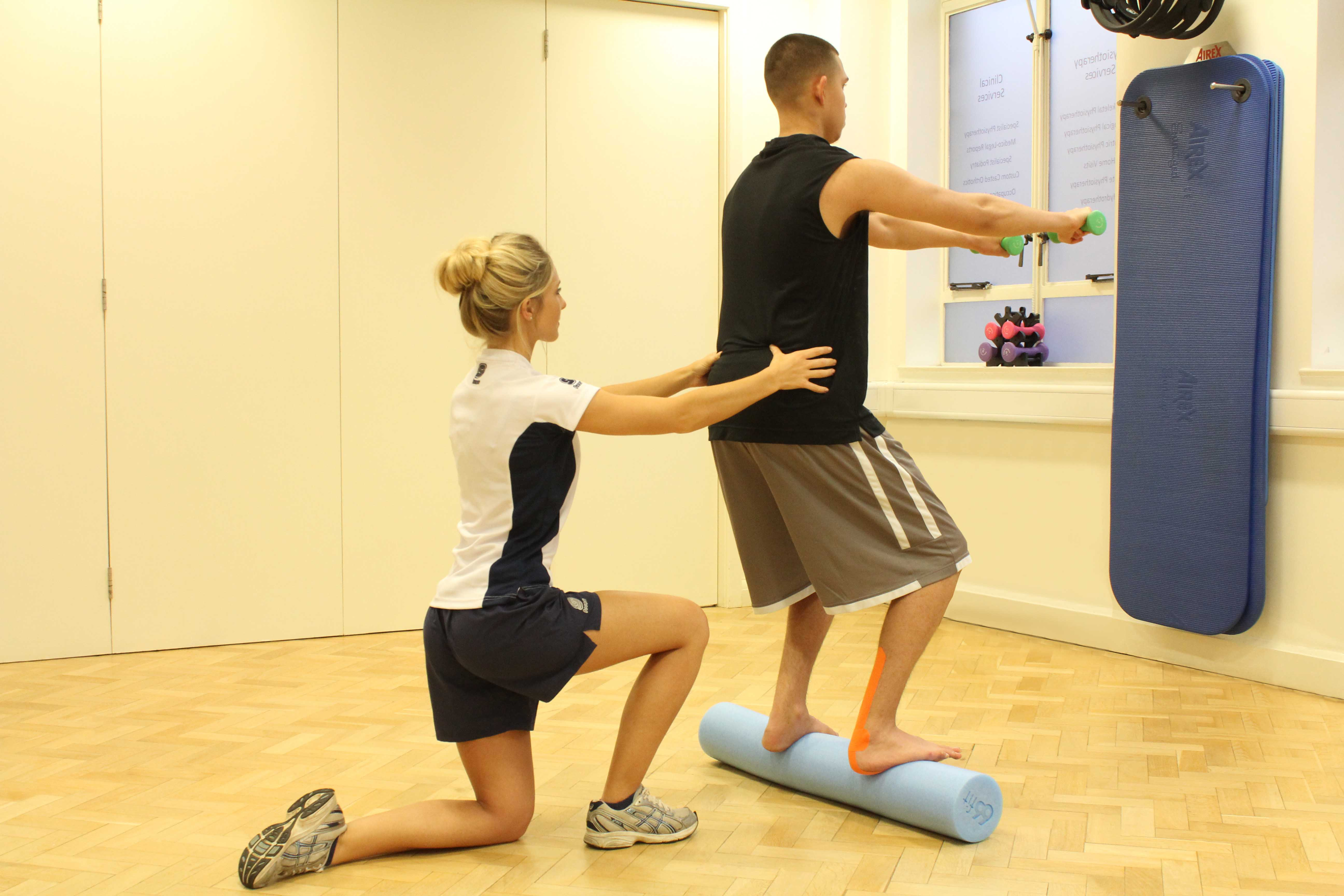 Ankle stability exercises, with supportive tape, supervised by therapist
