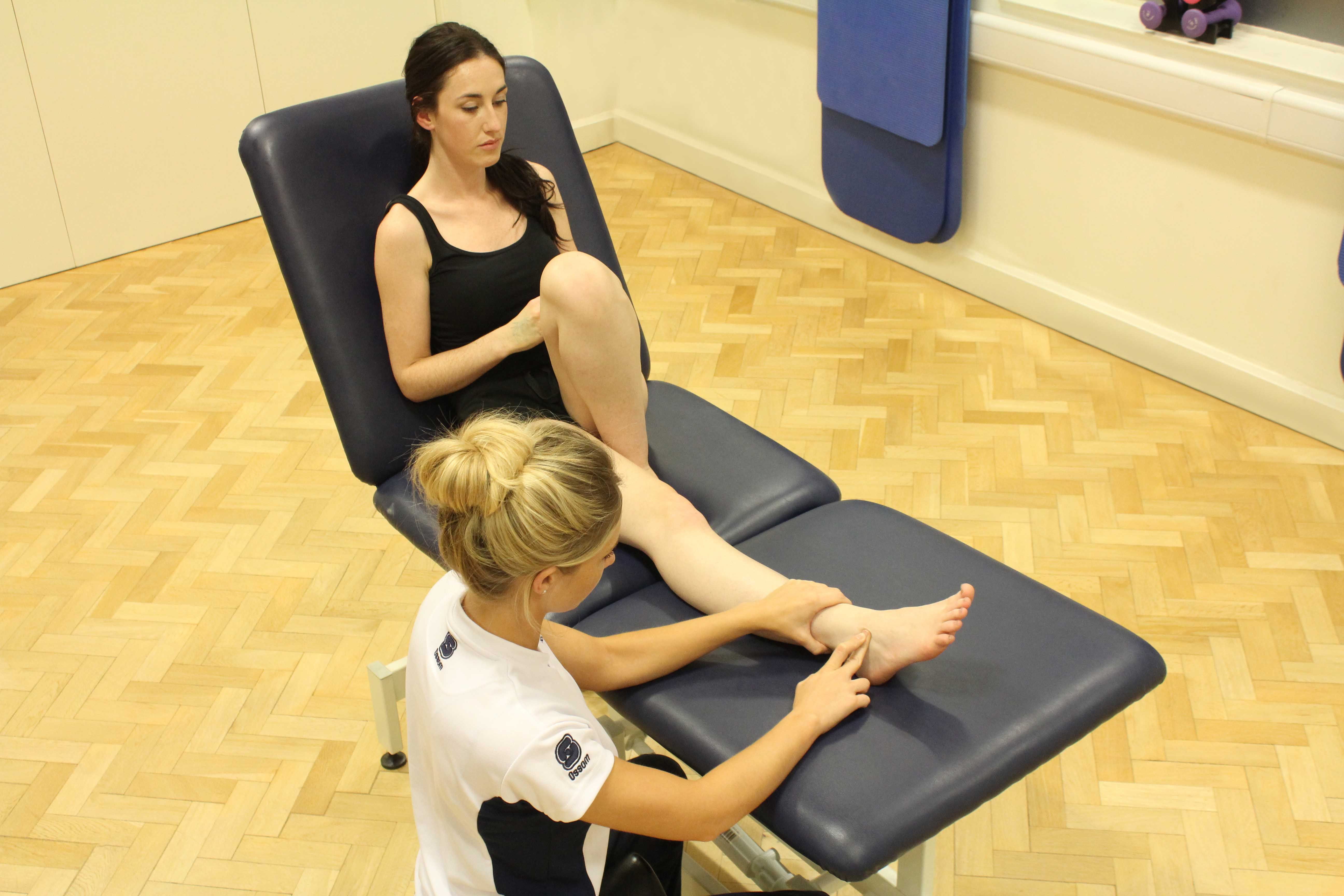 Friction massage applied to the inferior peroneal retinaculum ligament.