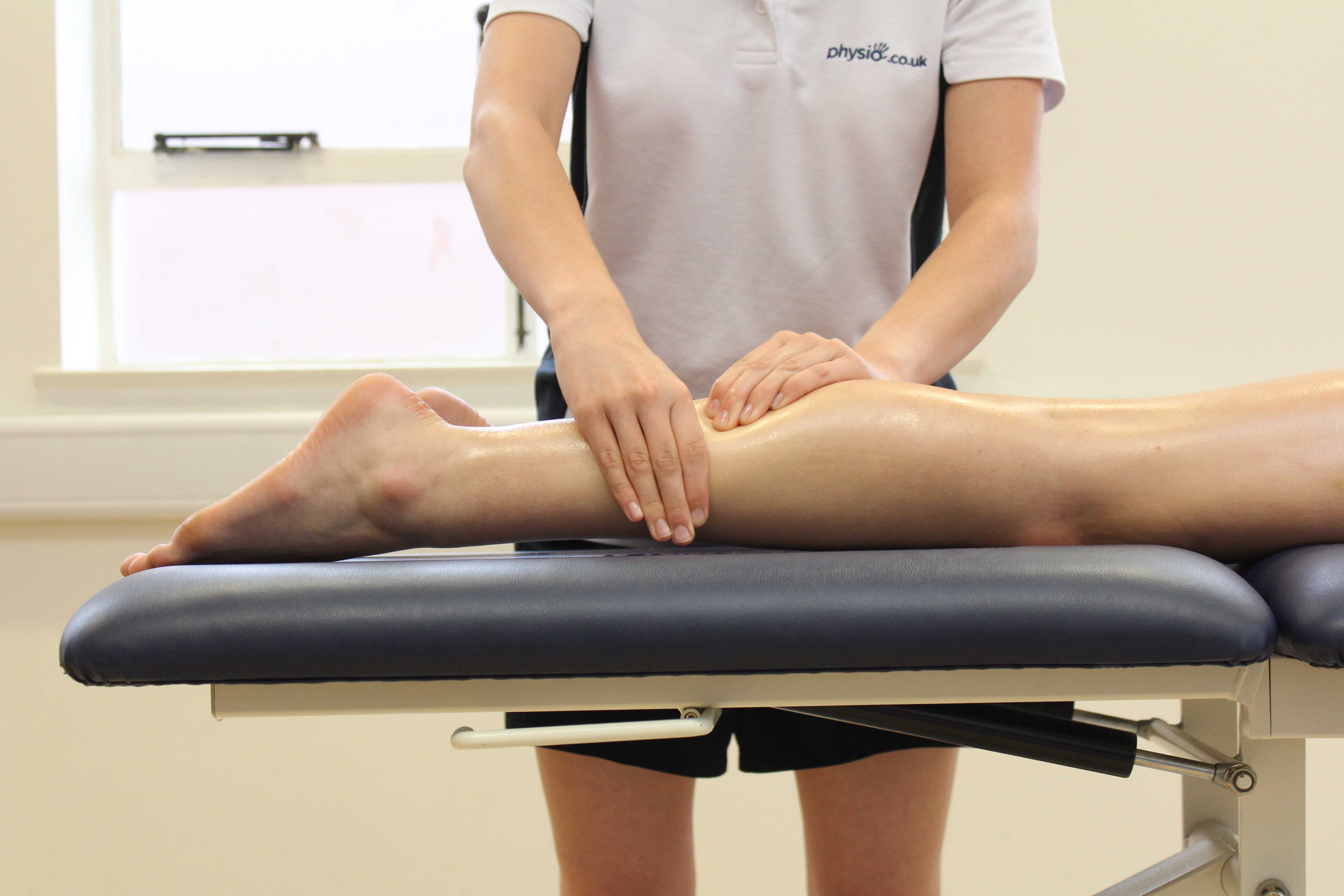 Rolling soft tissue massage applied to the gastrocnemius muscle by experienced therapist