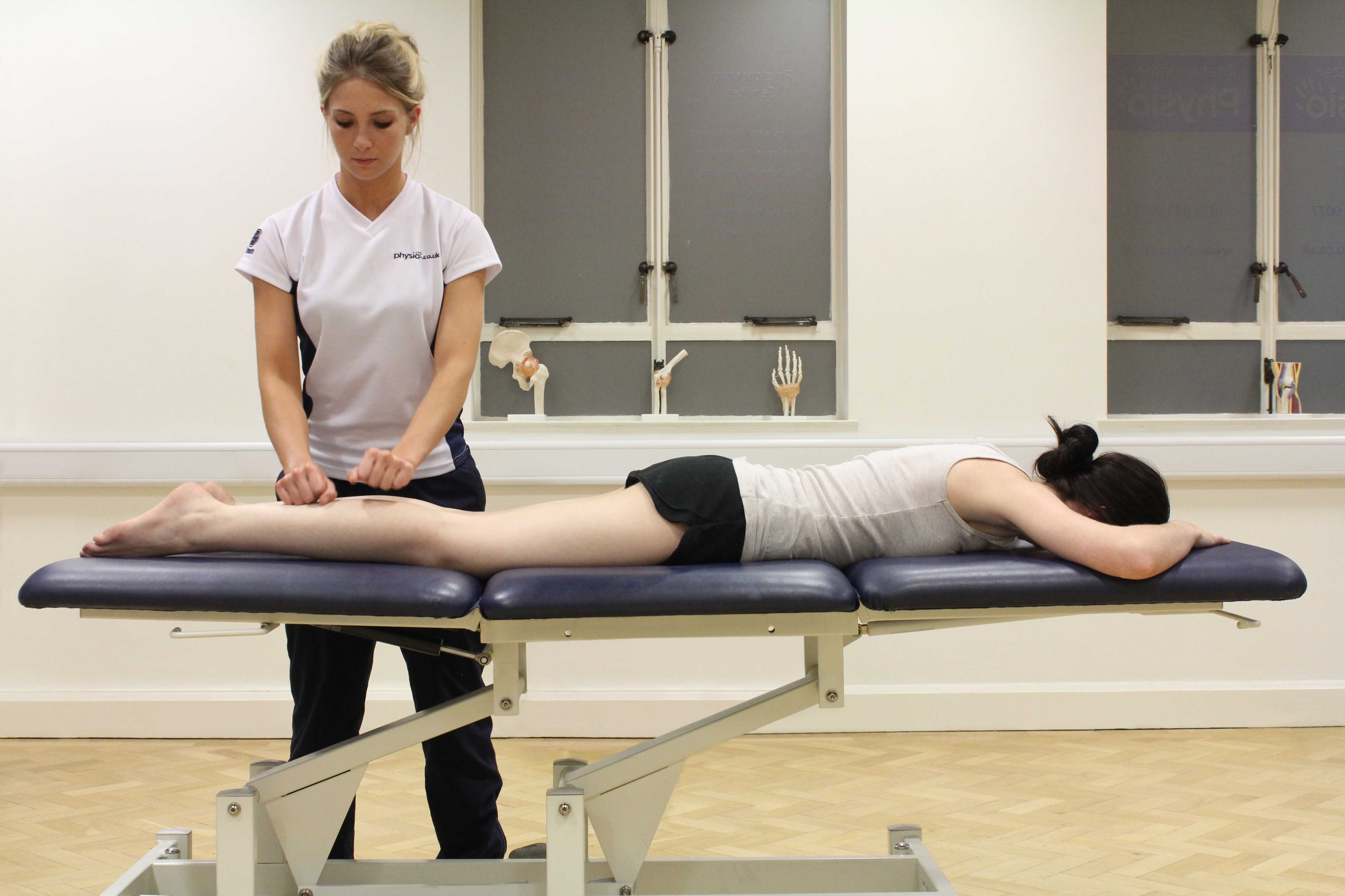 Beating percussion massage applied to the gastrocnemius muscle by experienced therapist
