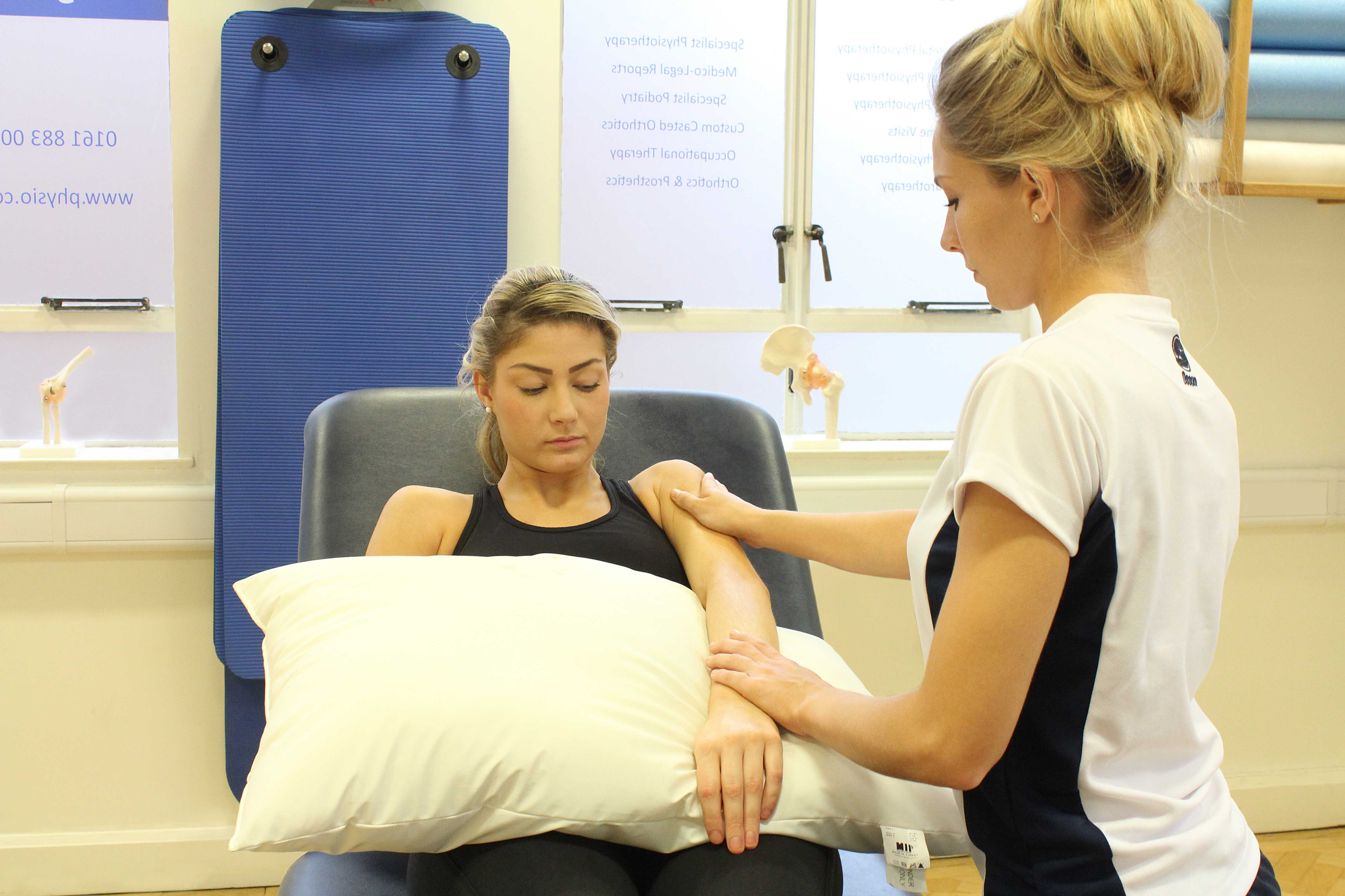 Soft tissue massage of the biceps and deltoids of the upper arm