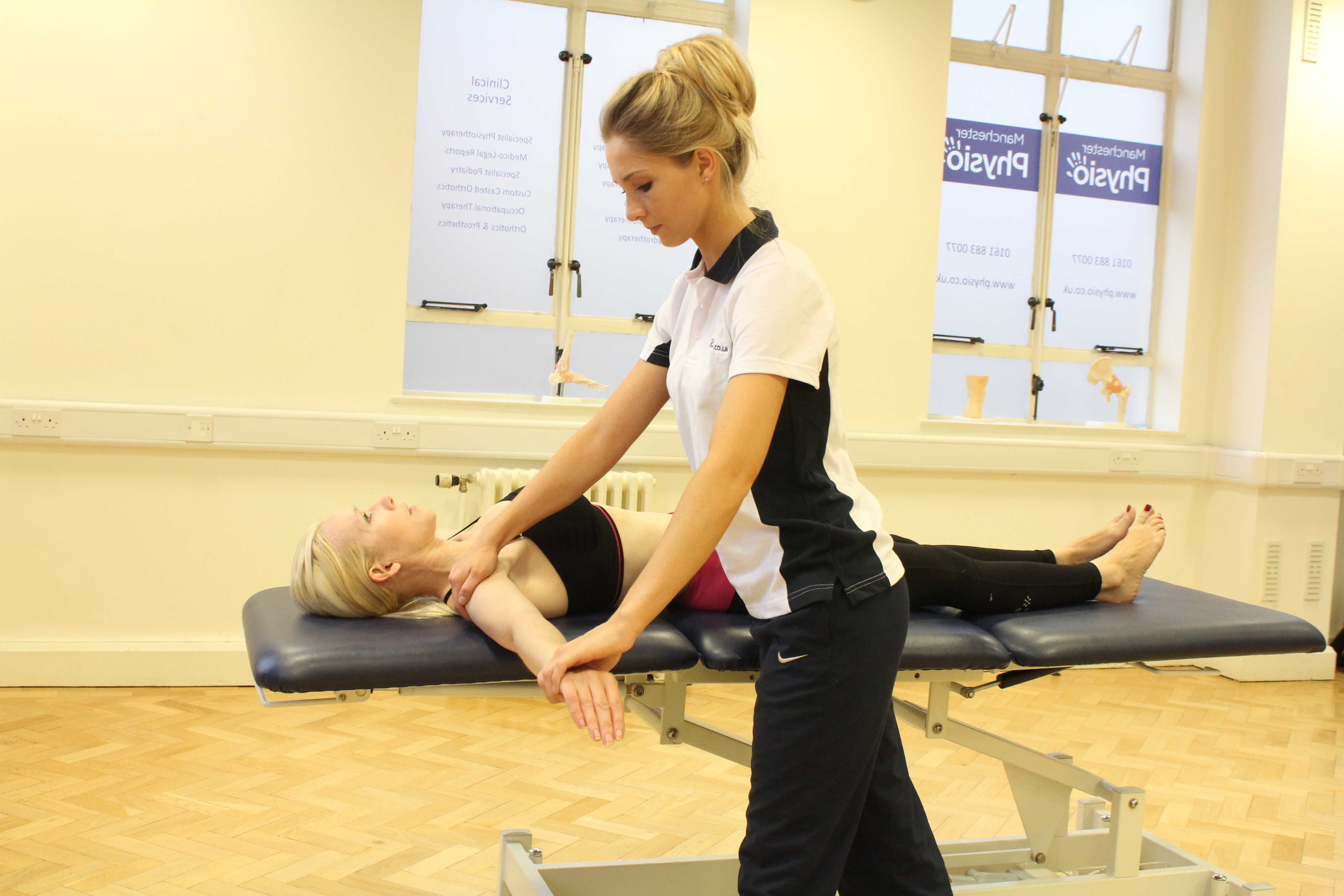 Therapist perfoming gentle passive mobilisation exercises on the glenohumaral joint