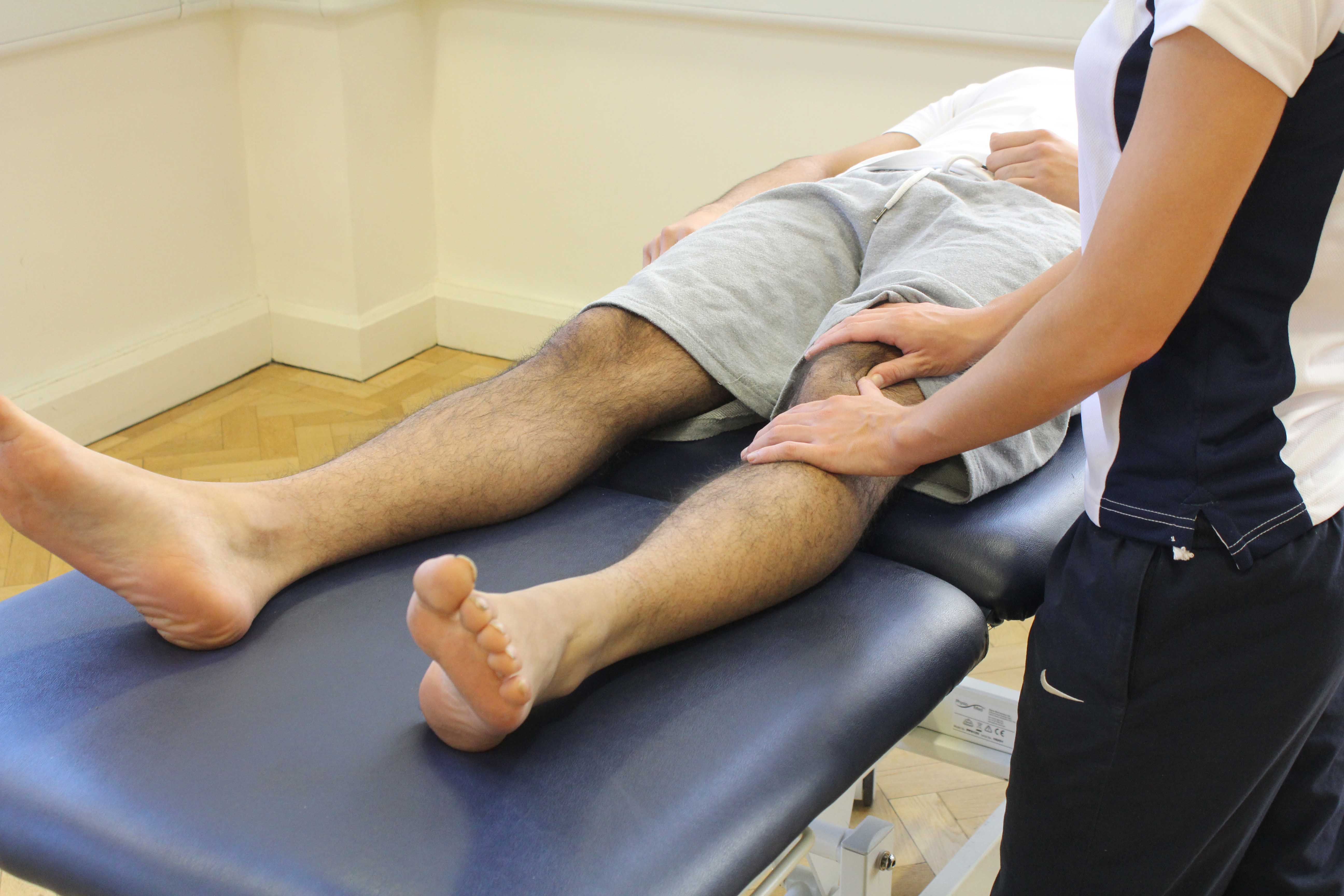 Therapist performing soft tissue massage and mobilisations on the patella and surrounding connective tissue.