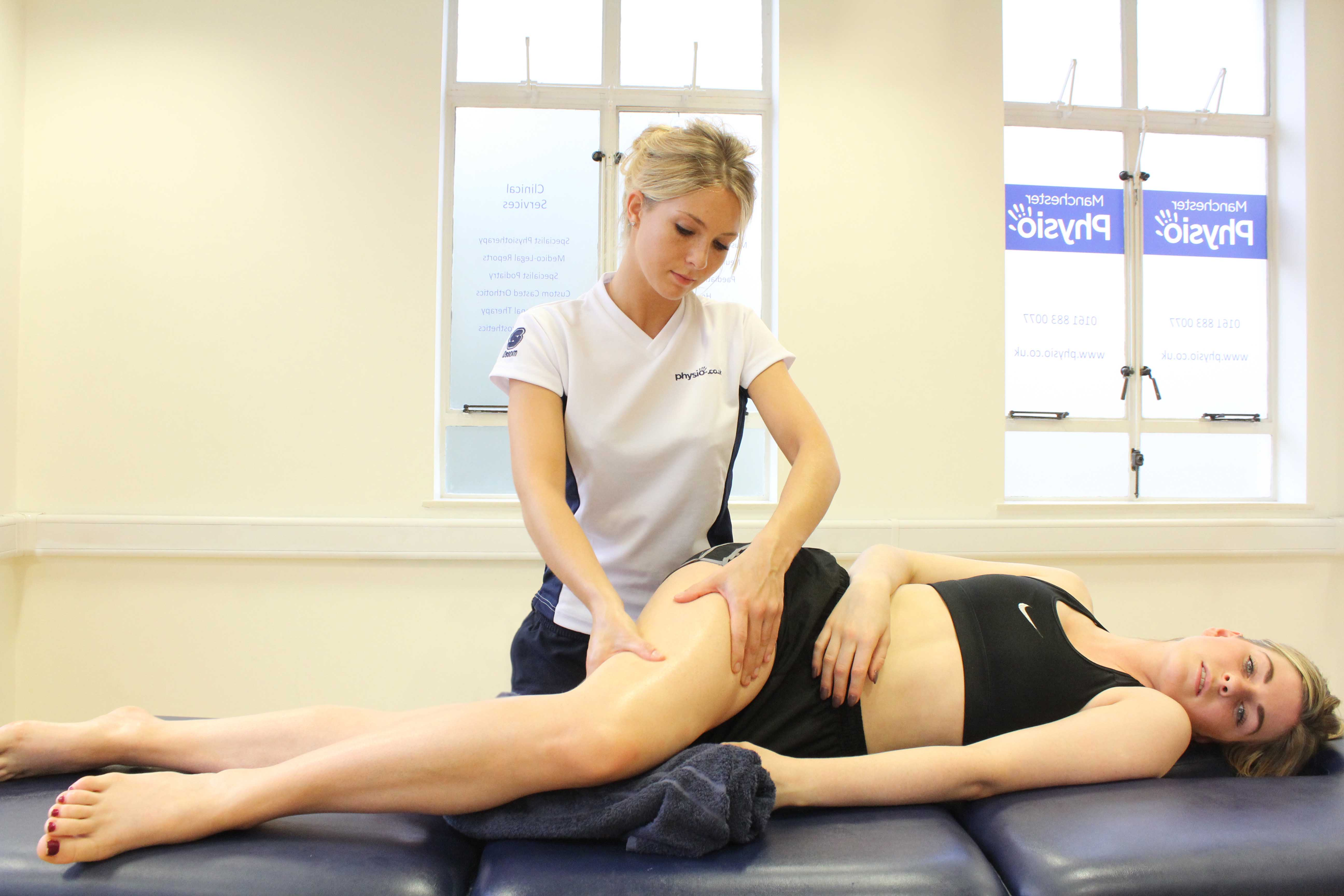Soft tissue massage of the muscles and connective tissues around the hip