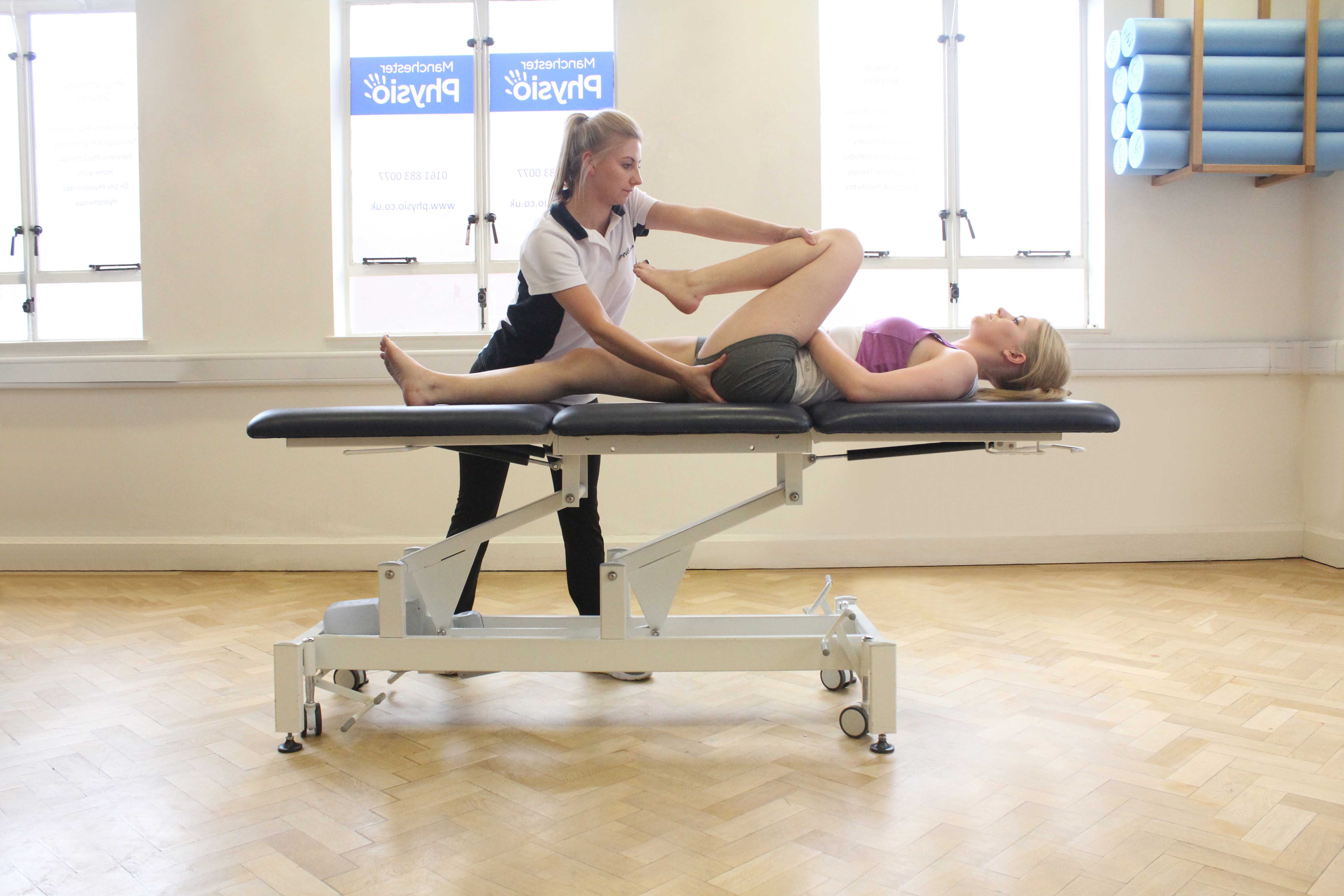 Deep tissue massage of the muscle and connective tissues around the hip.