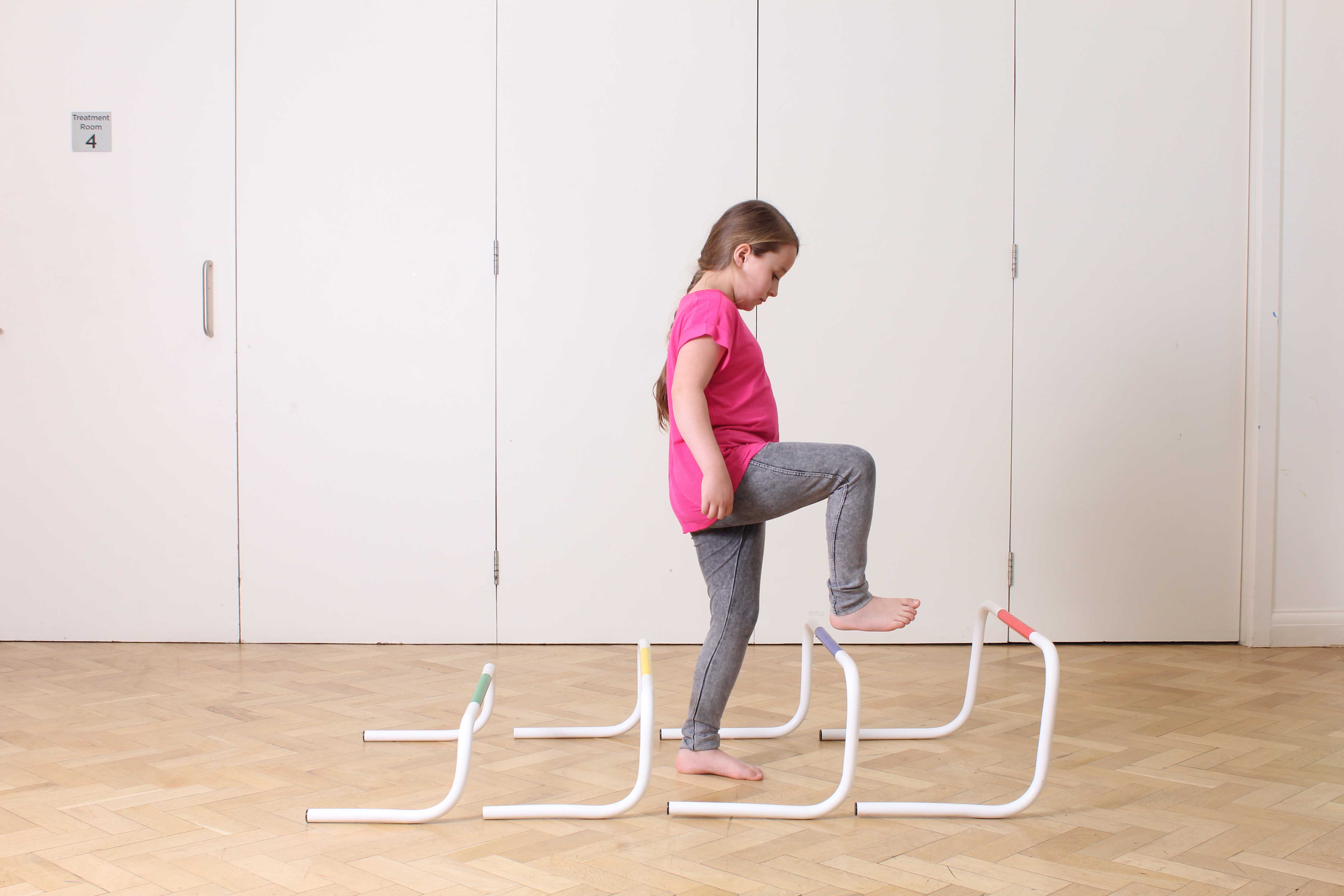 Gait re-education exercises between the parallel bars supervised by a paediatric physiotherapist