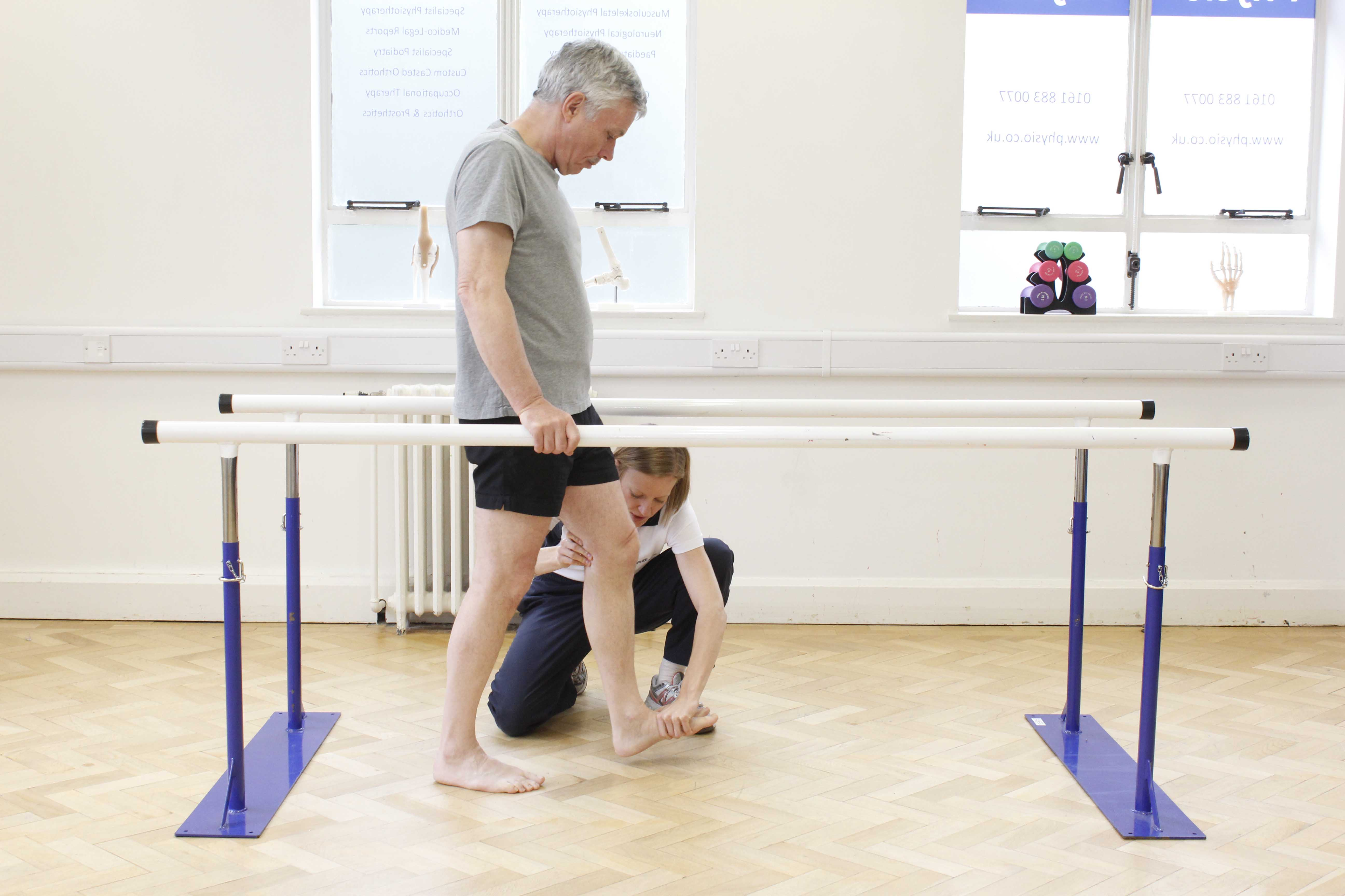 Gait re-education exercises closely supervised by a specialist neurological physiotherapist