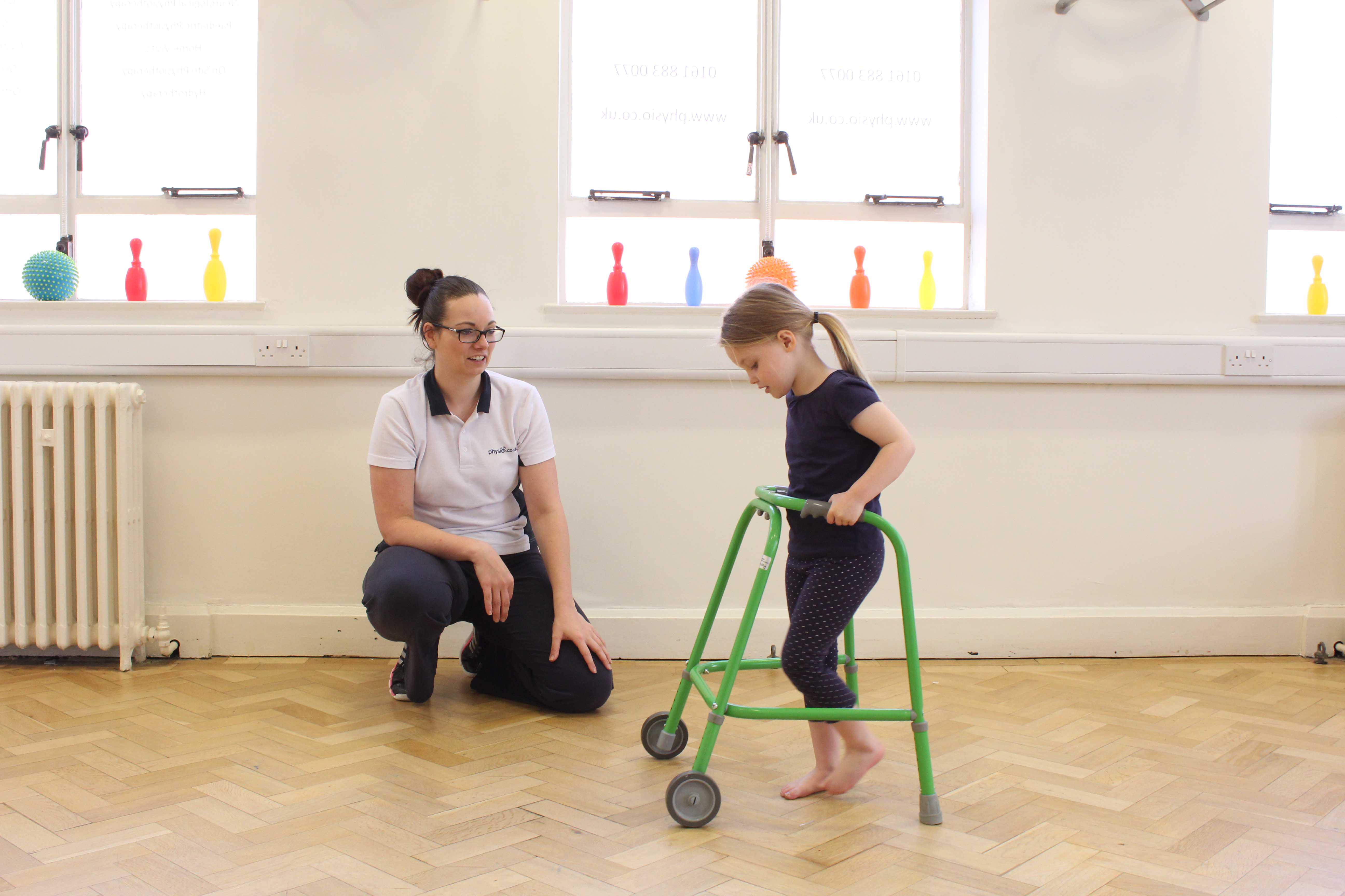 Gait re-education using a wheeled walking frame under close supervision of specilist Paediatric Physiotherapist