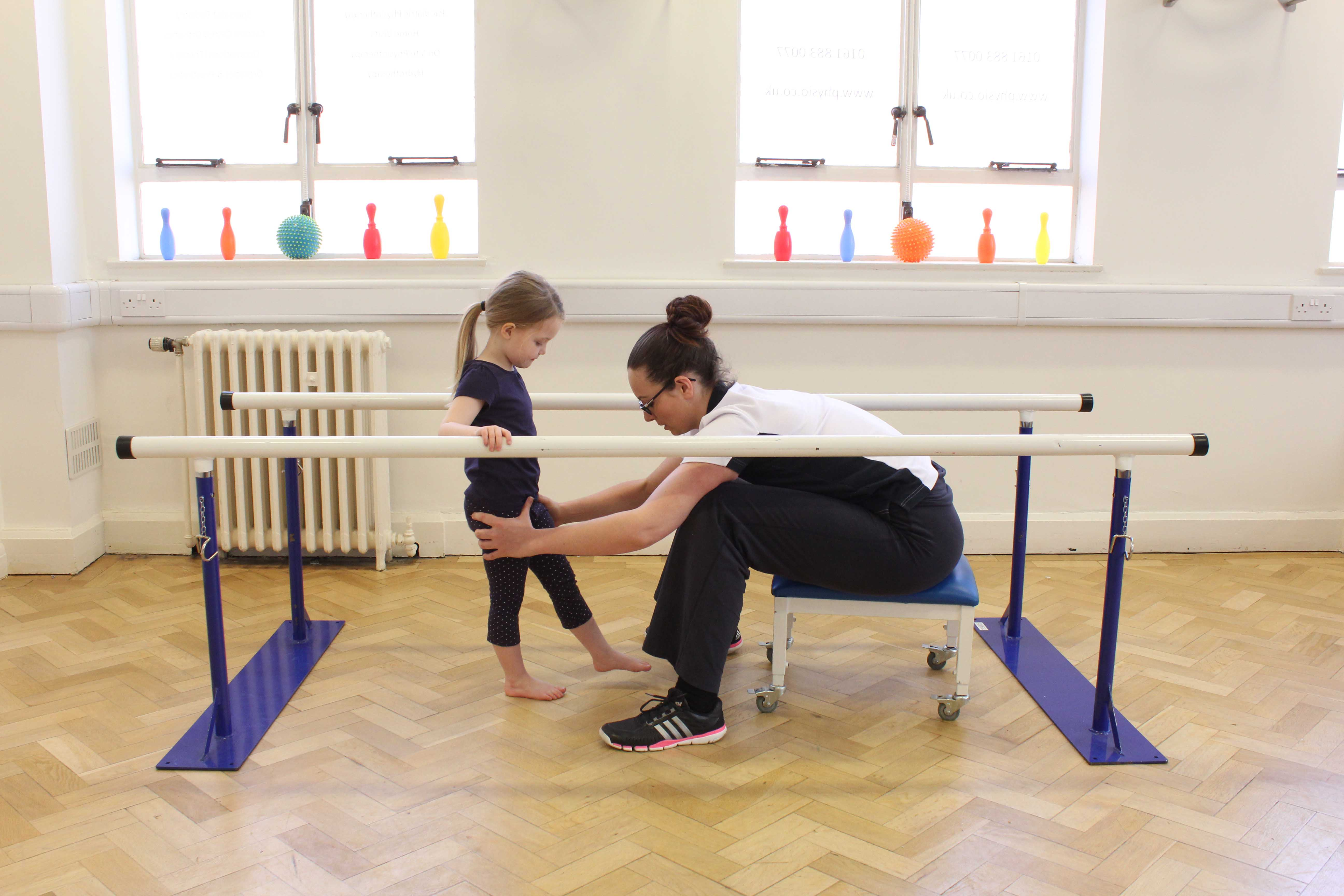 Gait re-education using the parallel bars under close supervision of specilist Paediatric Physiotherapist
