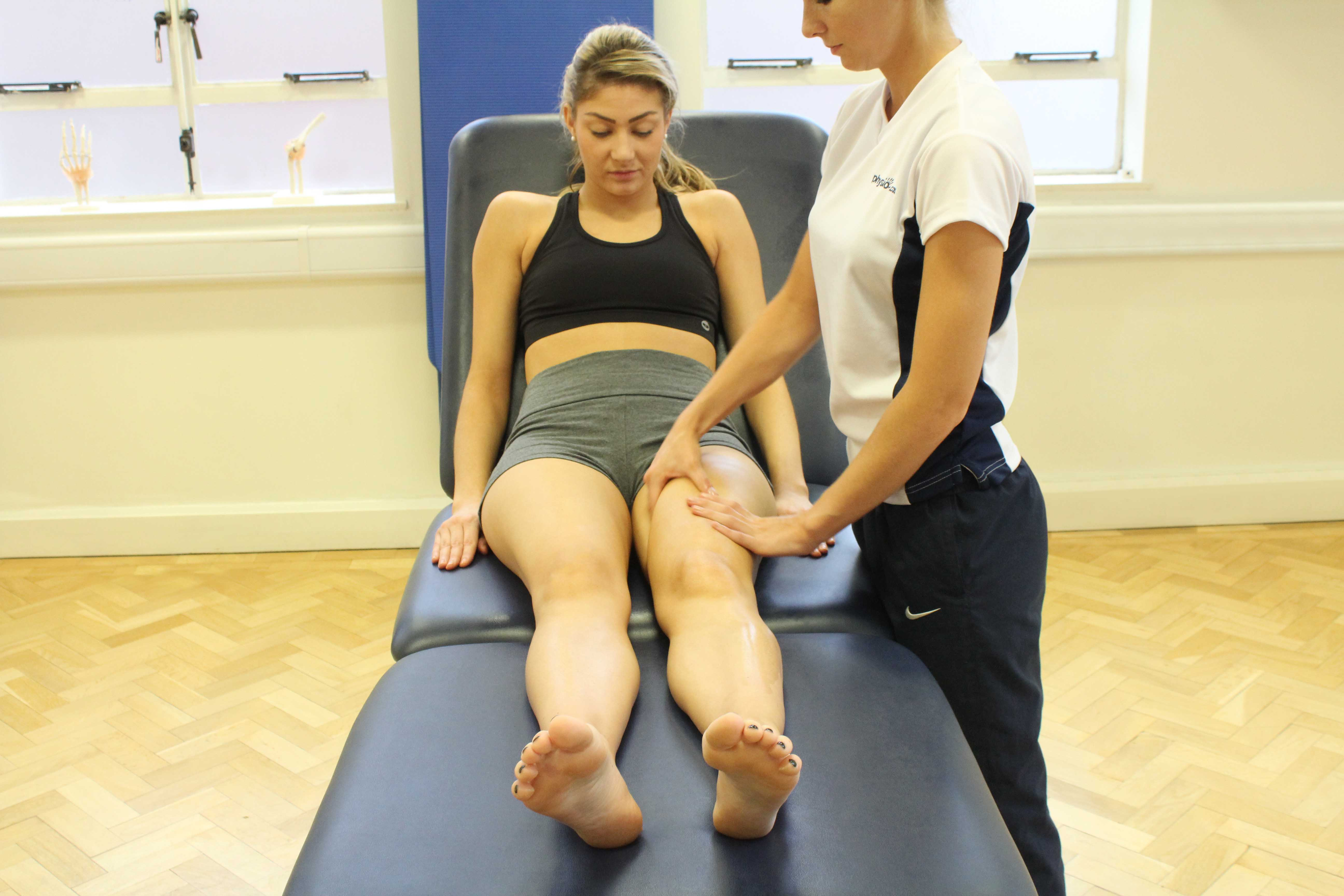 Soft tissue massage of the muscles and connective tissues around the hip and groin