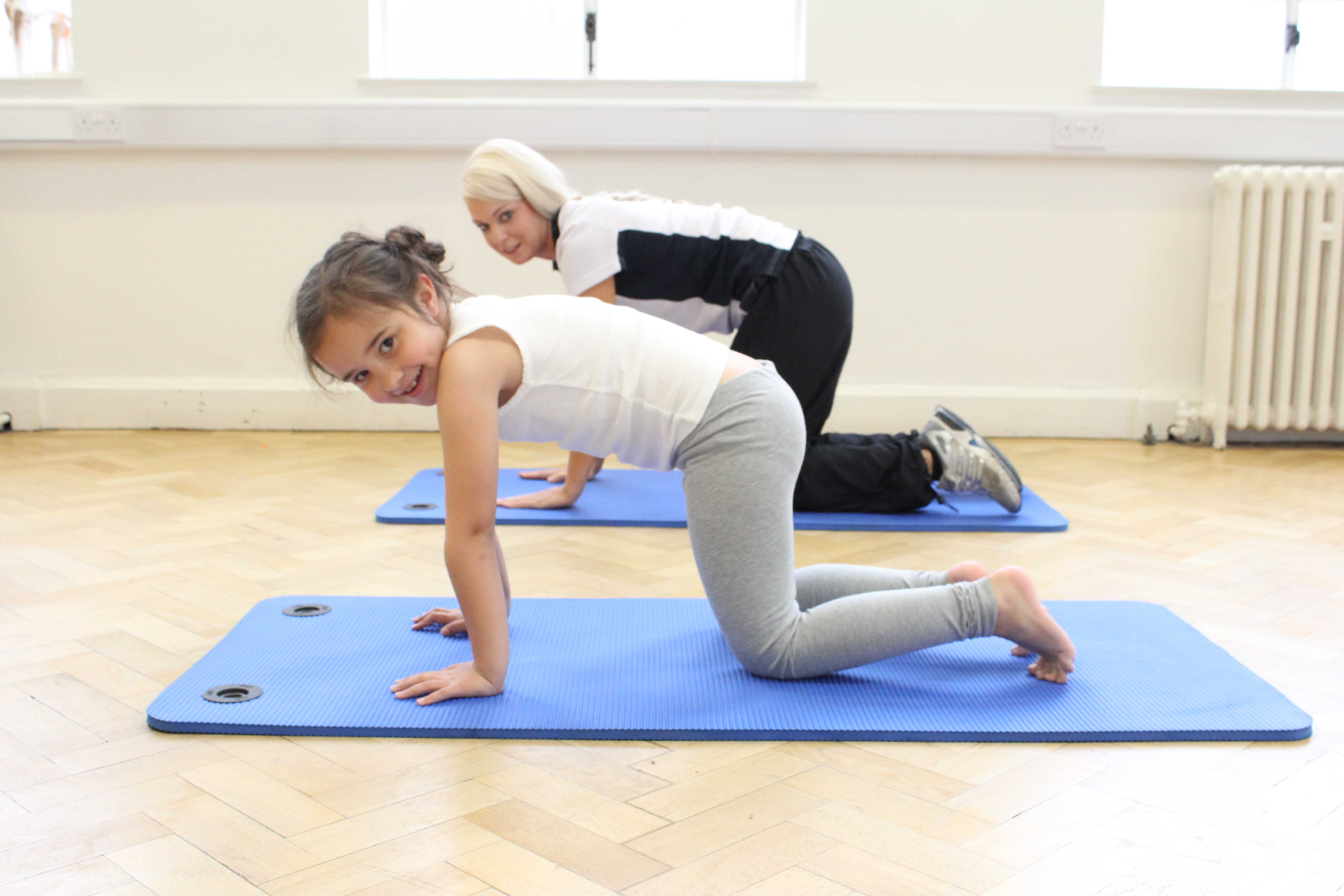 Stertches and toning exercises supervised by specilaist paediatric physiotherapist