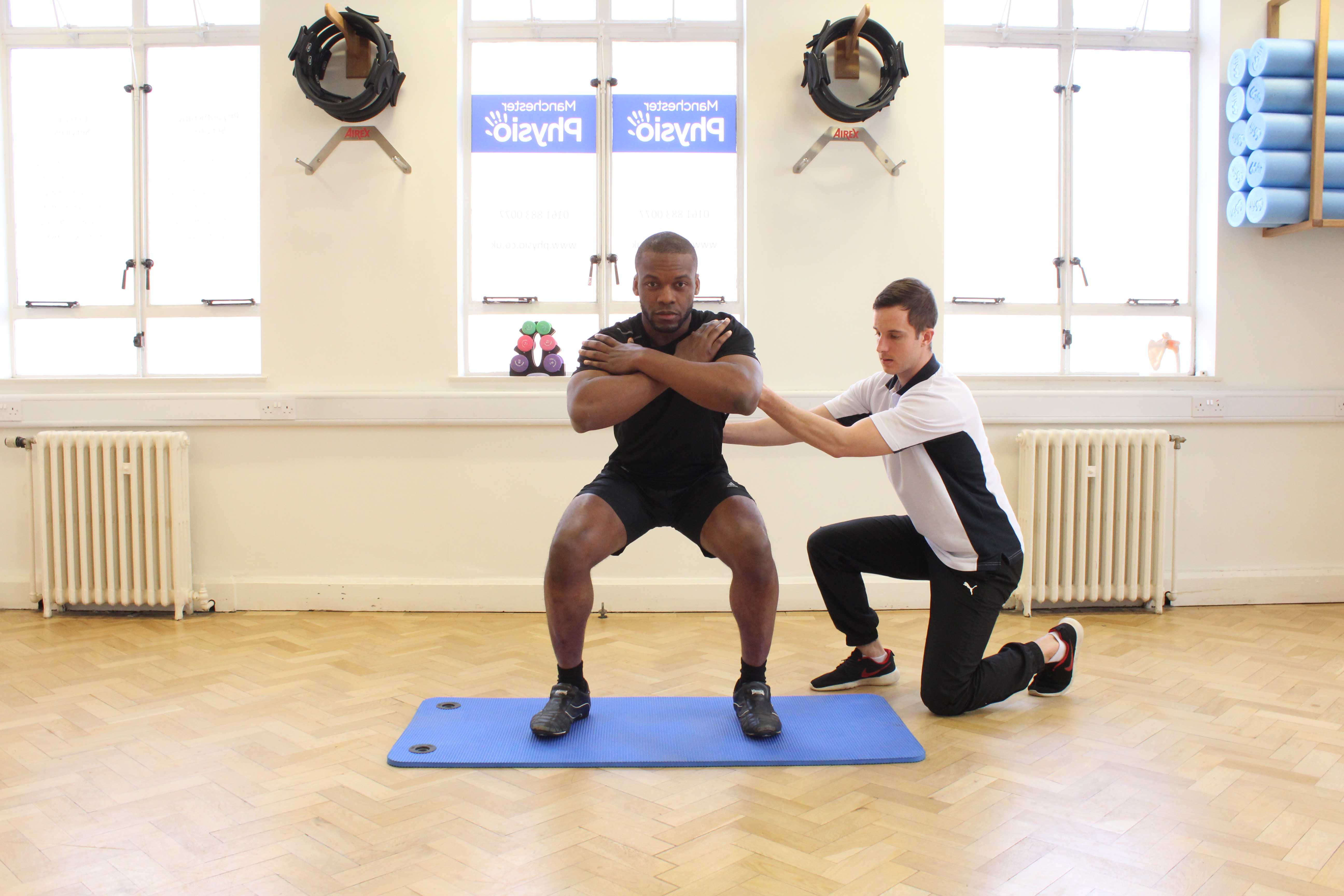 Progressive quadricep strengthening exercises supervised by specialist MSK therapist