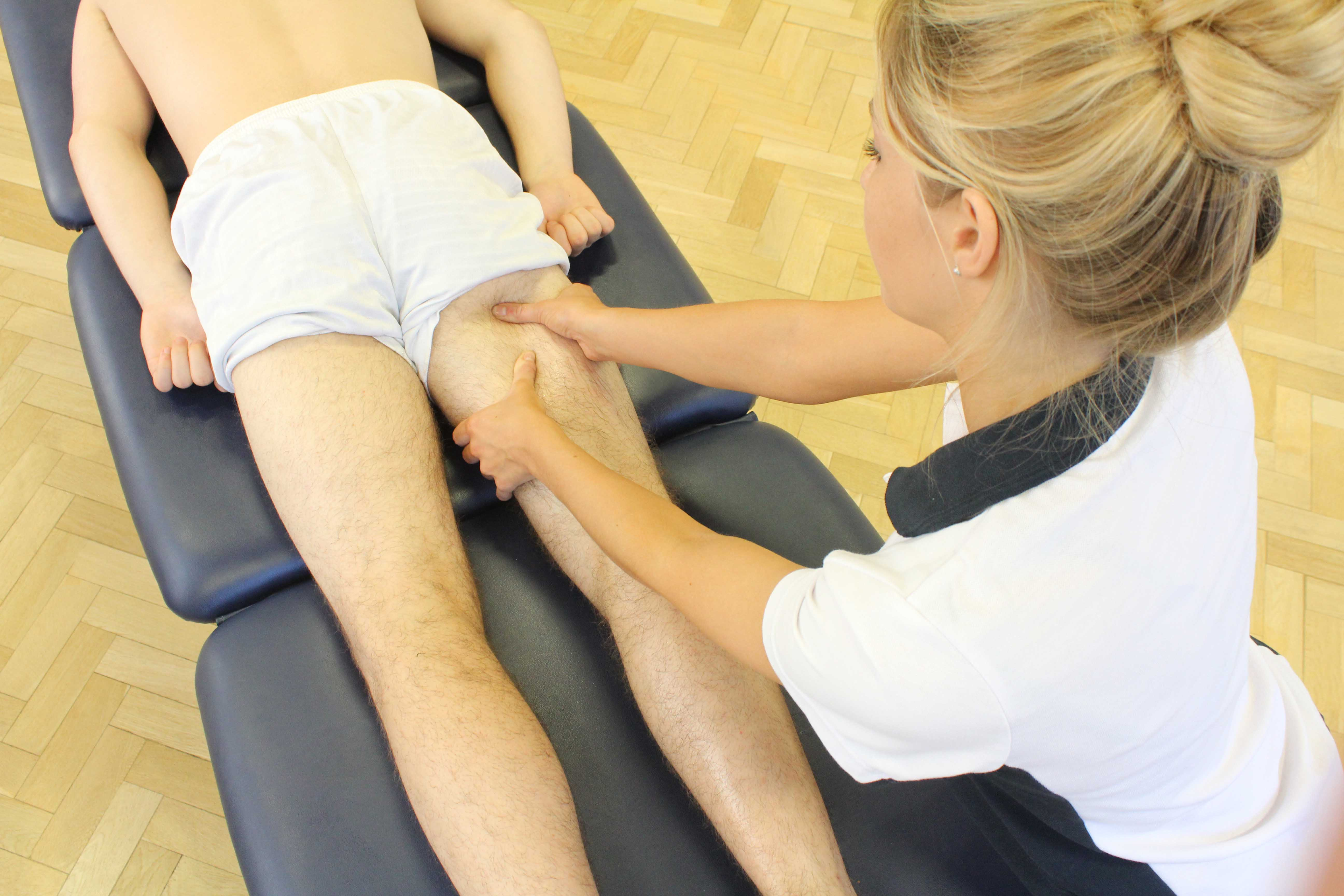 Trigger point massage of the hamstring muscles by experienced MSK therapist