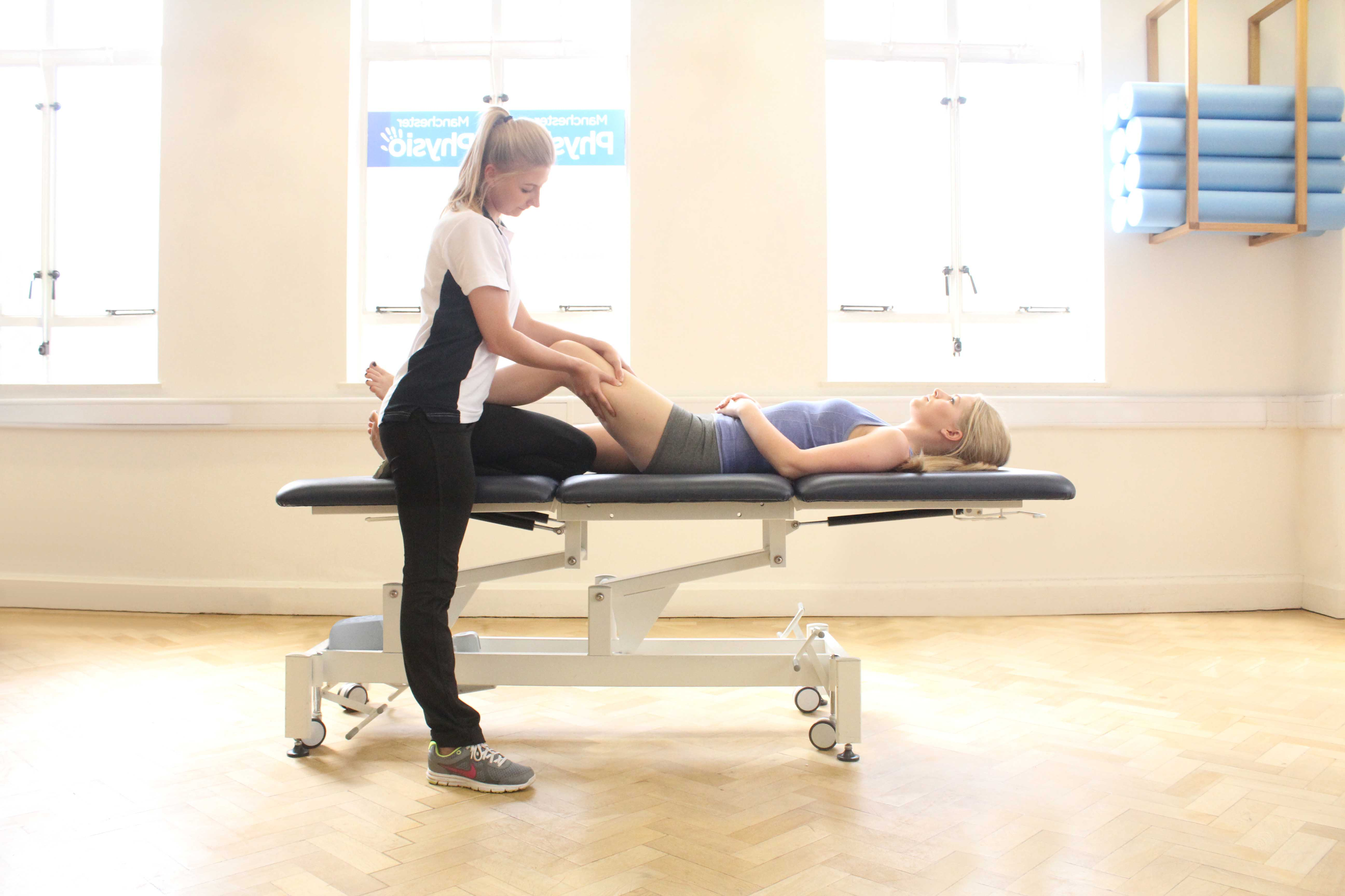 Trigger point massage applied to the quadricep muscles