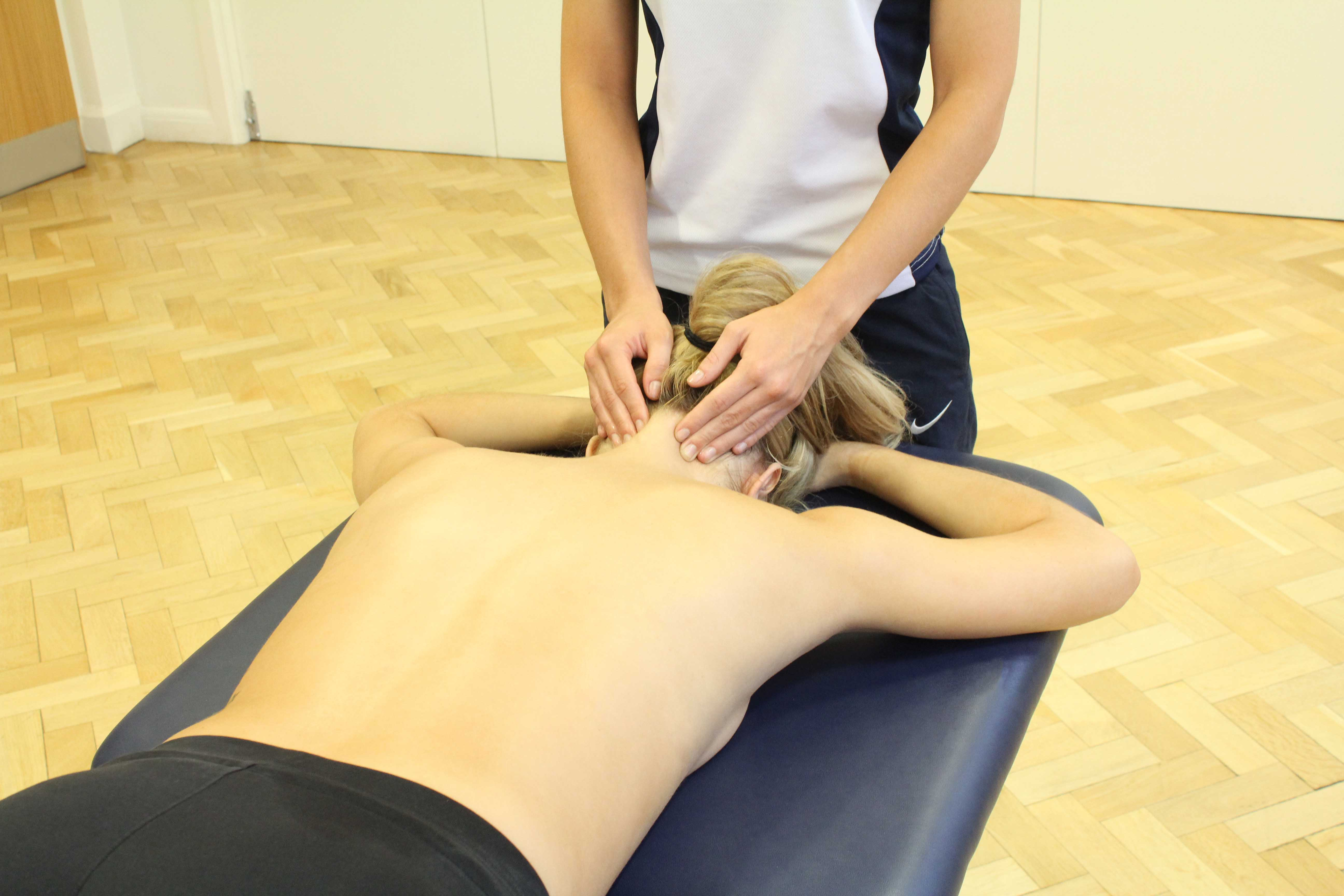 Soft tissue massage and mobilisations of the head and cervical spine to relieve pain and tension