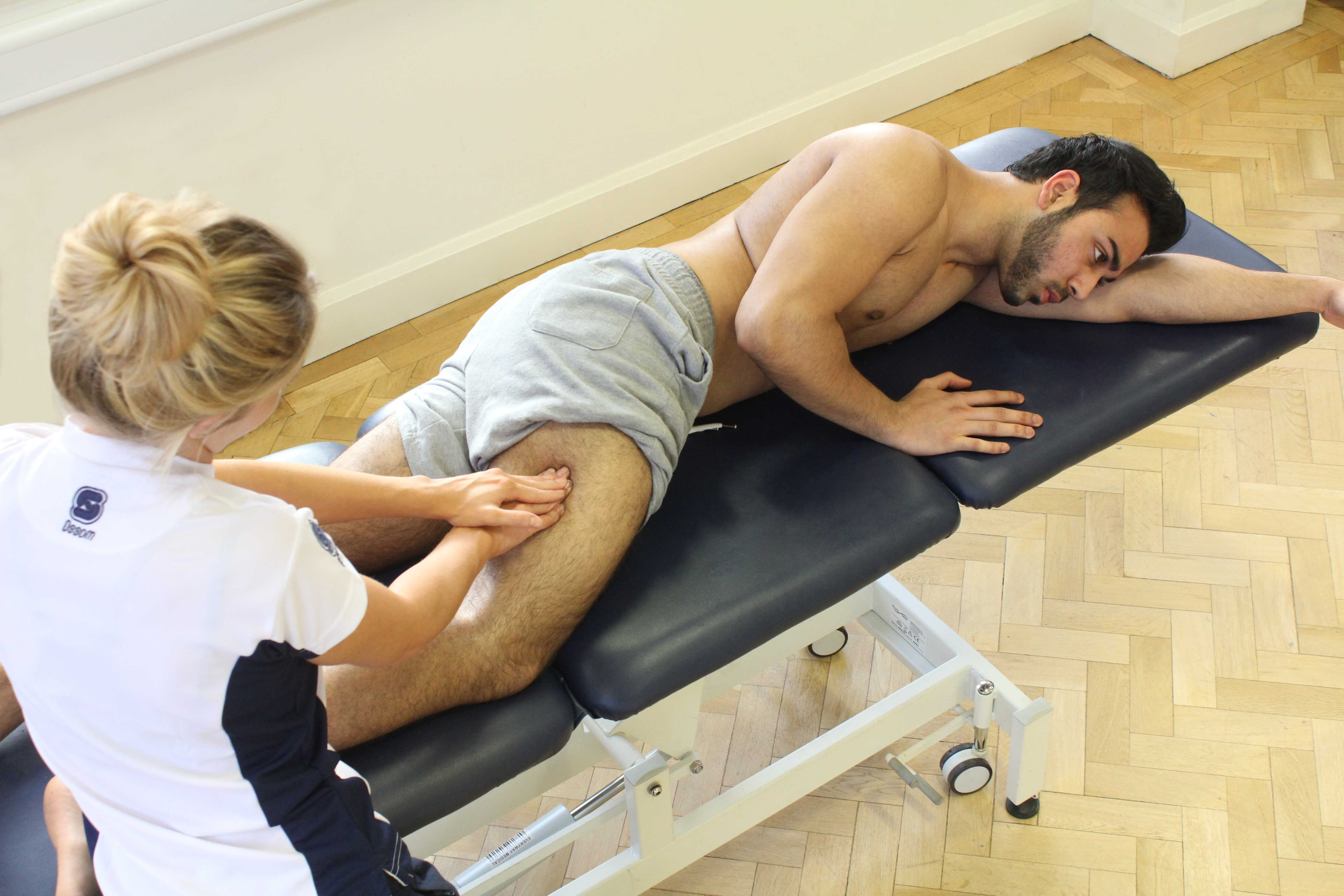 Deep tissue massage of the vastus lateralis following heat treatment