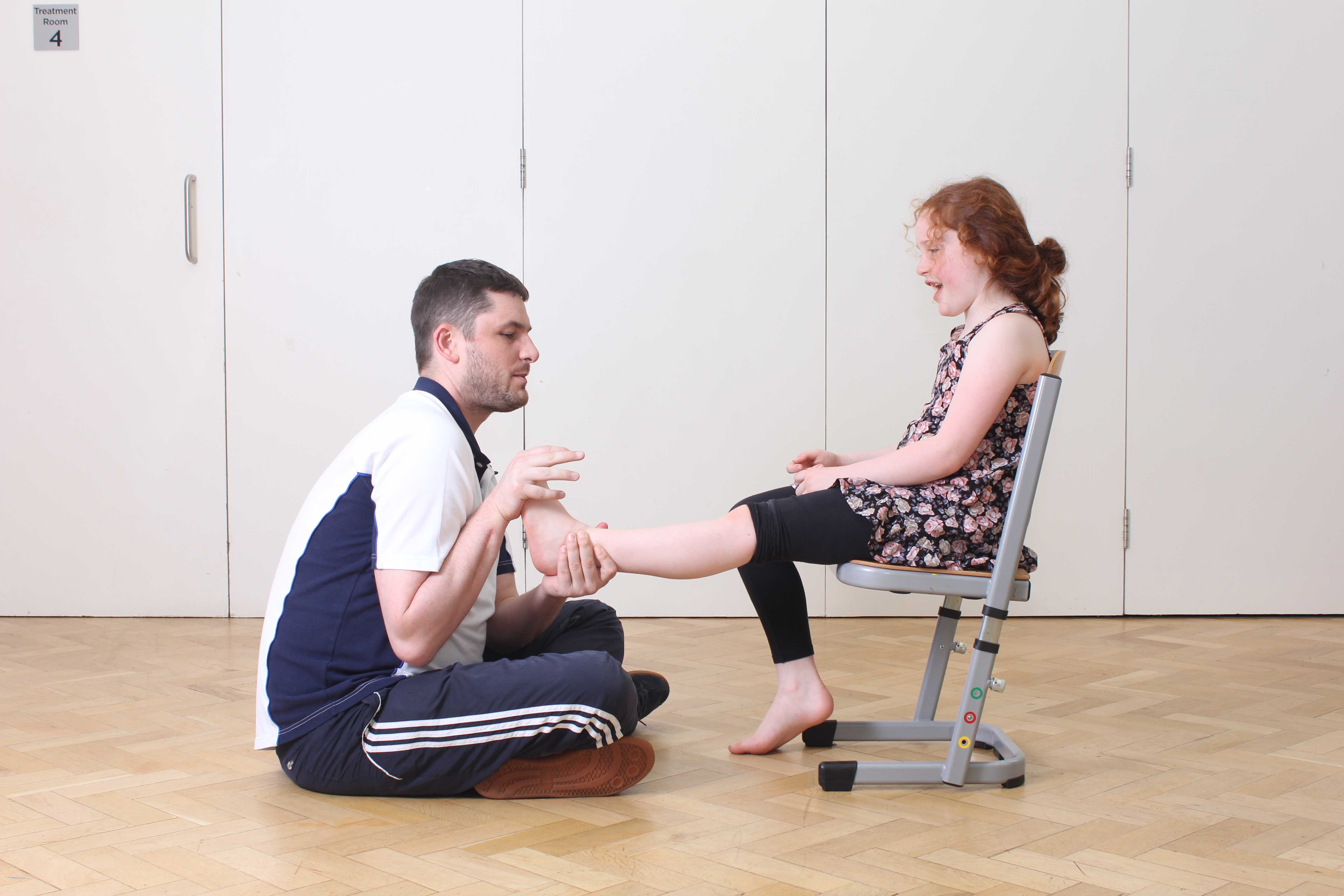 Mobilisations and stretches by a paediatric physiohterapist to reduce heel pain and stiffness