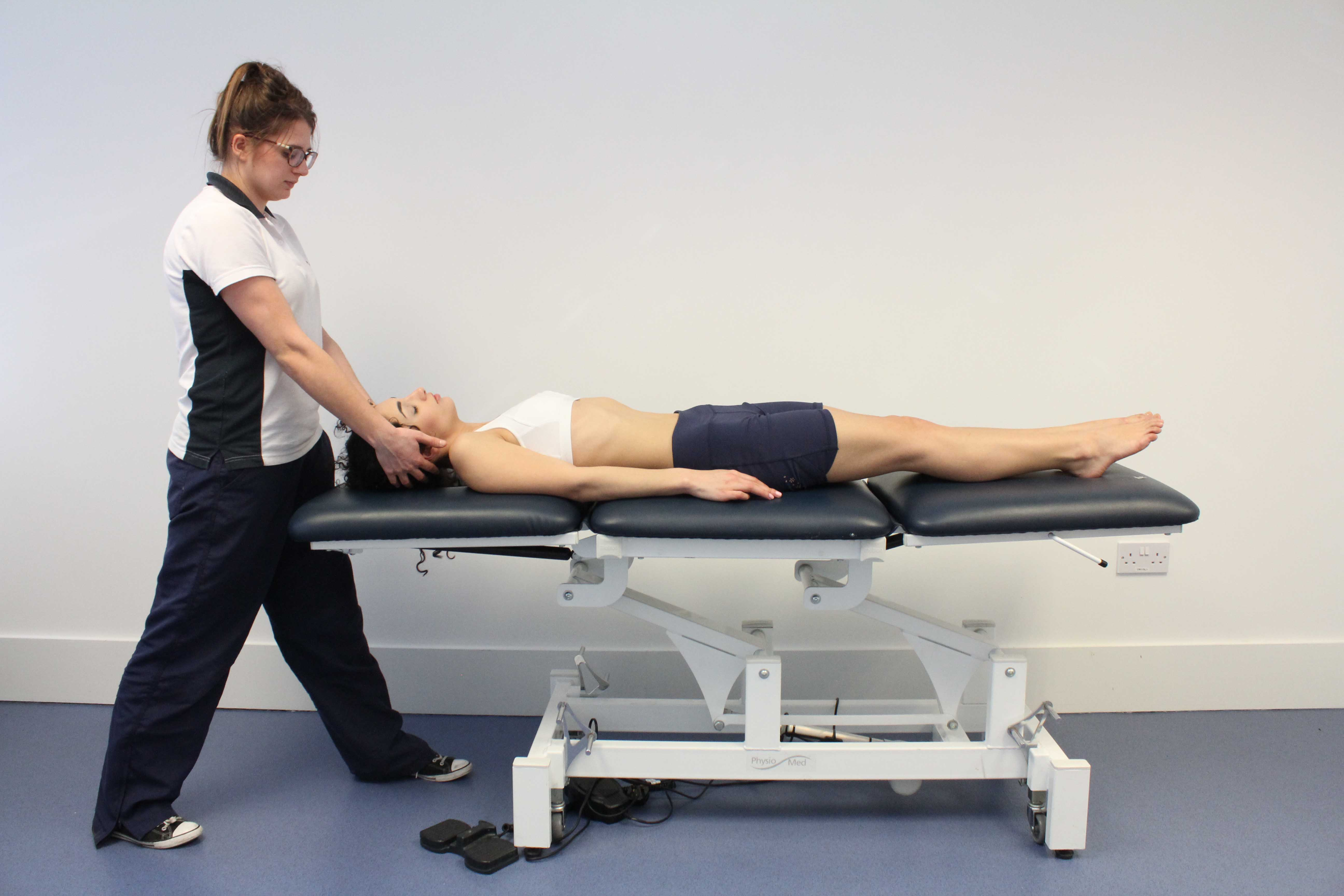Passive stretches and mobilisations by a physiotherapist of muscle and cervical vertebrea to relieve stiffness and pain