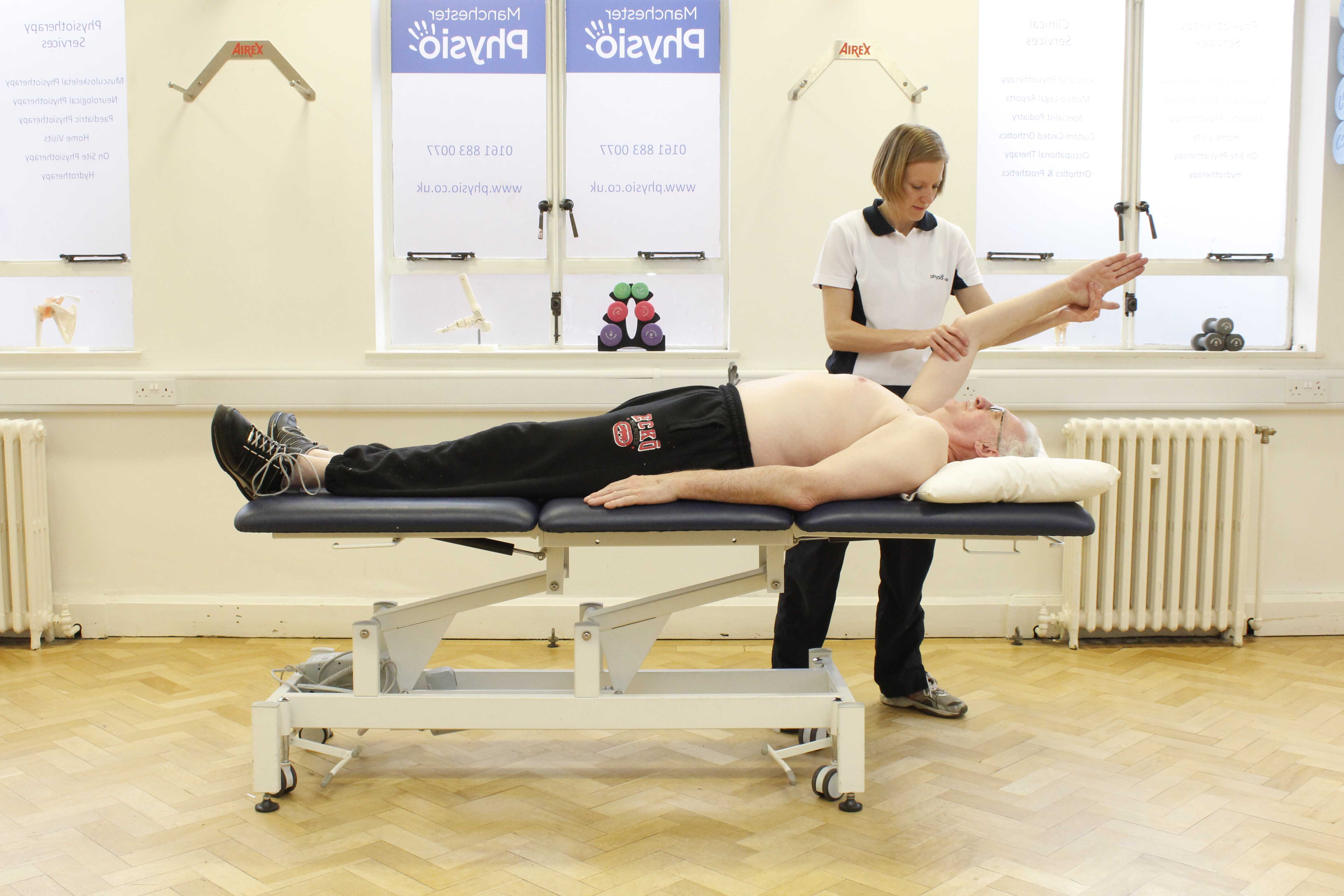 Passive mobilisations and stretches of the shoulder and elbow by a specilaist physiotherapist
