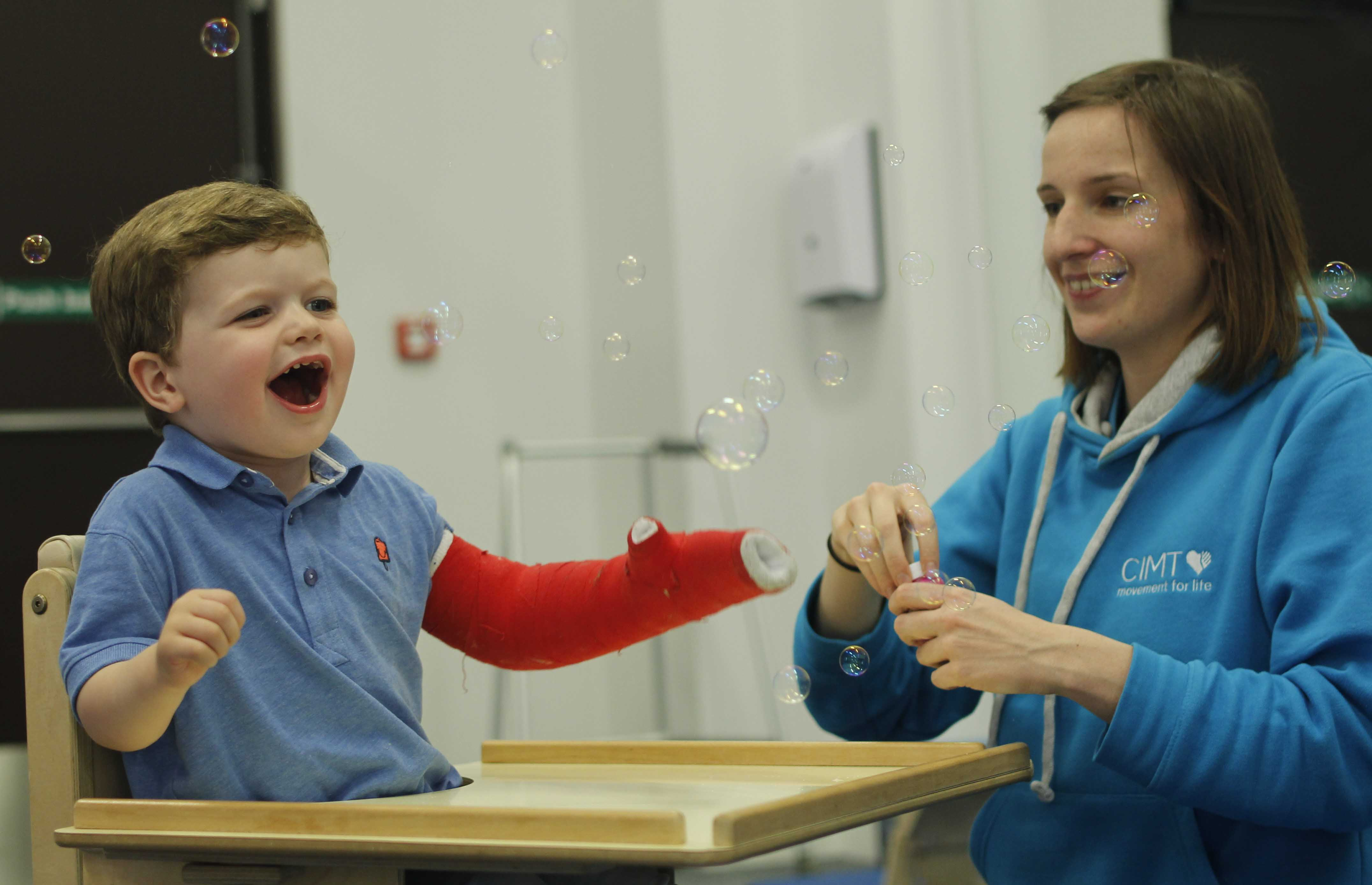 Our physiotherapist enjoying a CIMT session with our lovely little client.