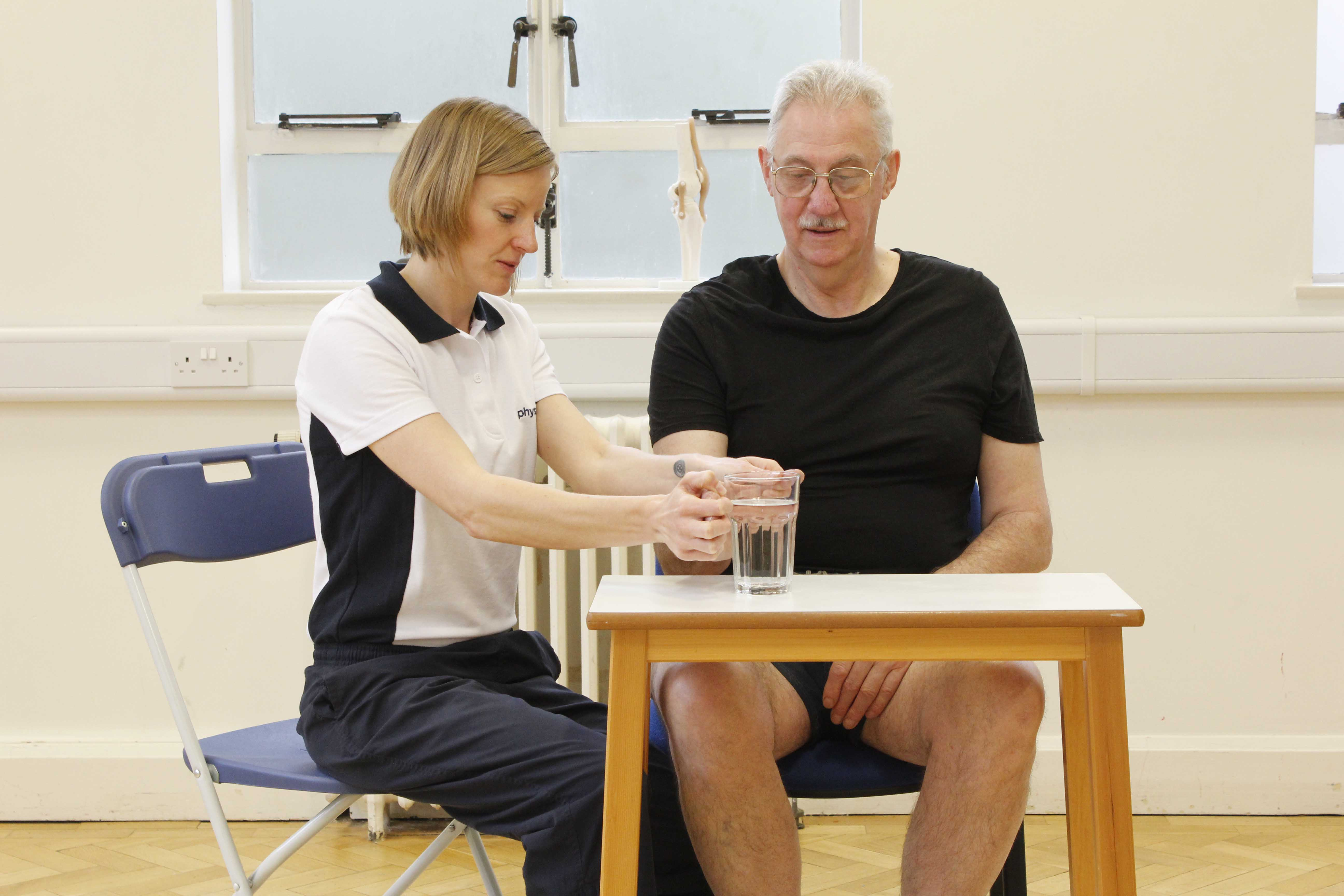 Functional movement rehabilitation exercises supervised by a specialist neurological physiotherapist