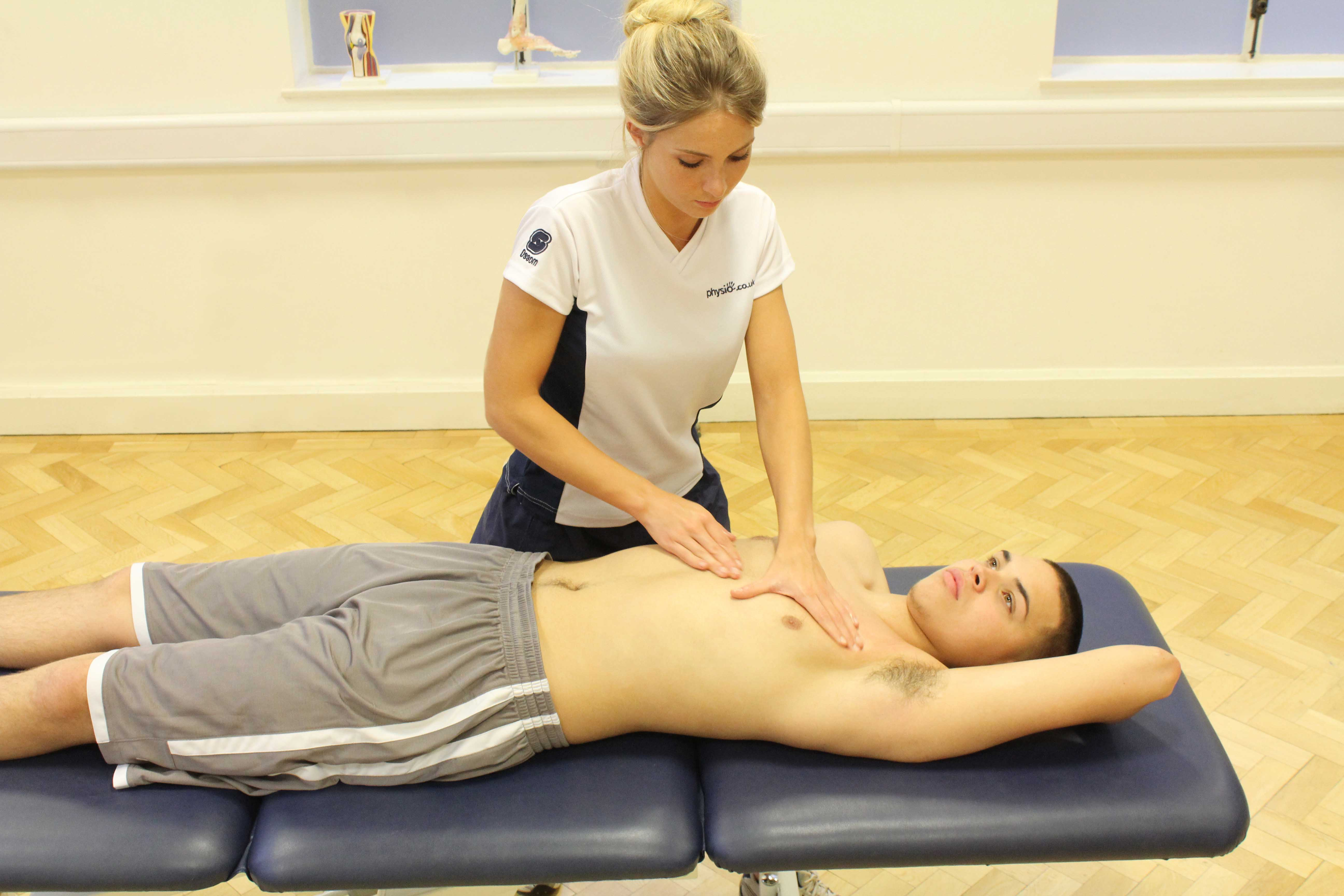Soft tissue massage of the pectrol muscles by a specialist therapist