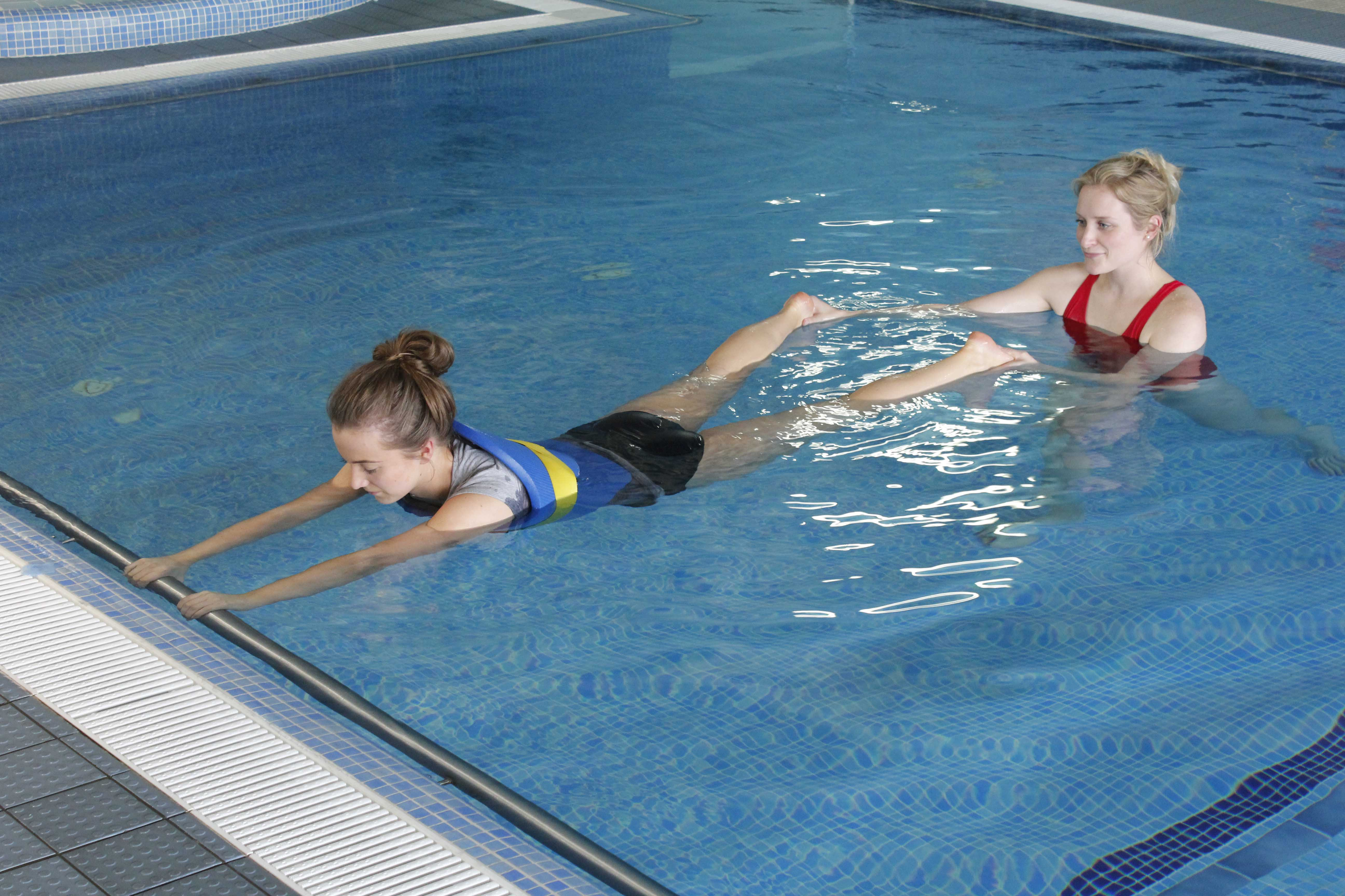 Hydrotherapy session with close supervision from specialist physiotherapist