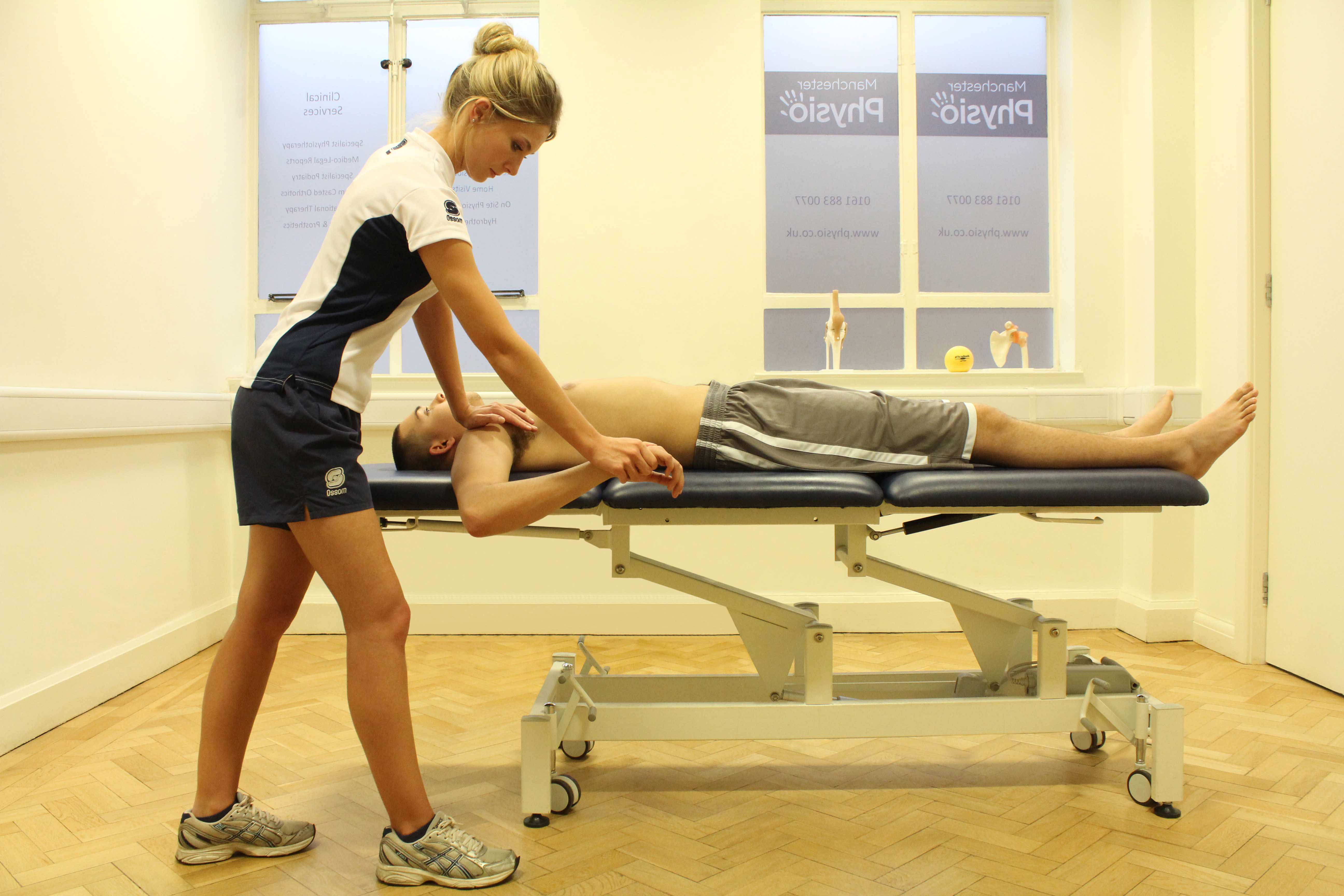 Examination of finger hyperextension injury by experienced physiotherapist