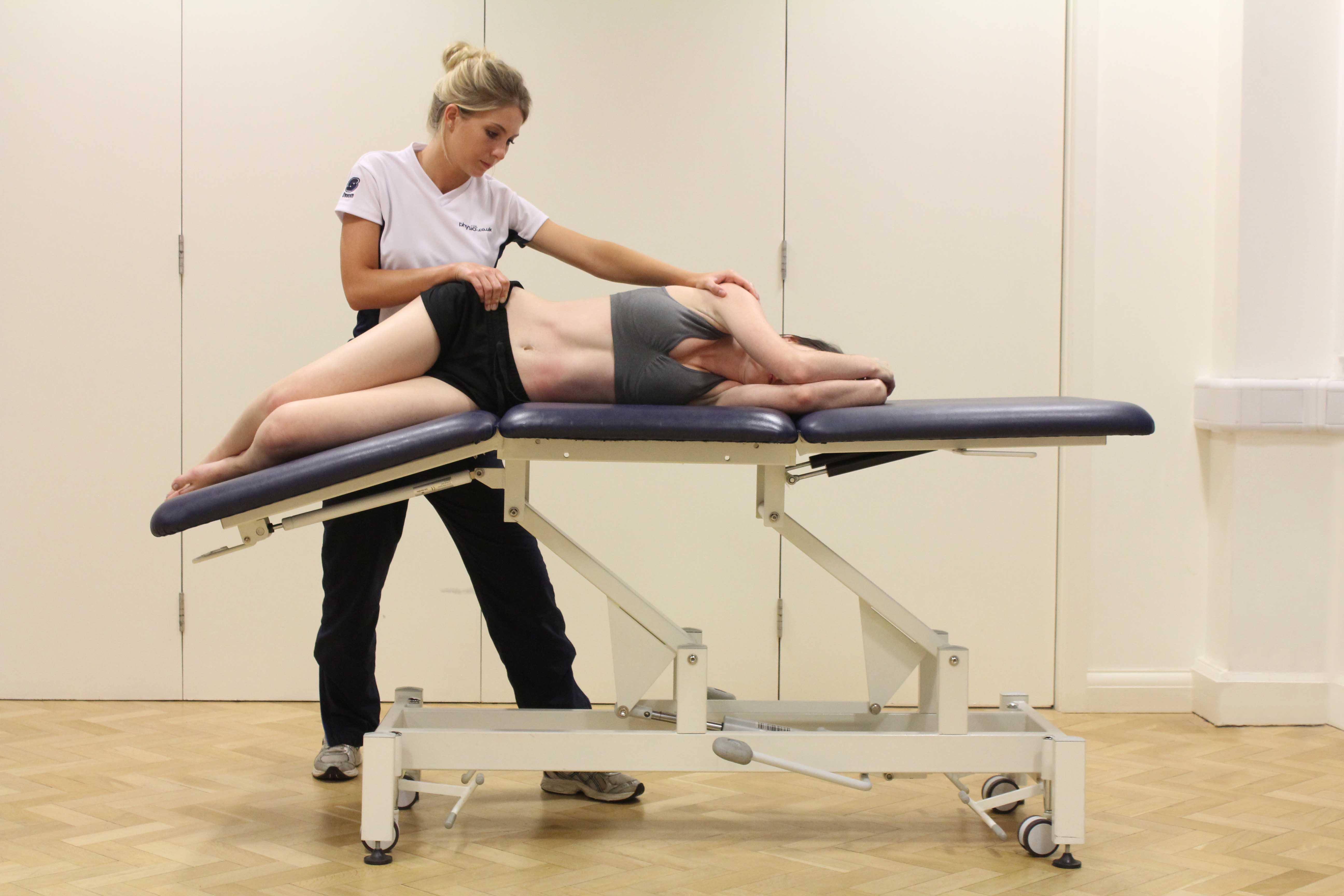 Passive stretch of the hip and pelvic muscles by specialist MSK therapist