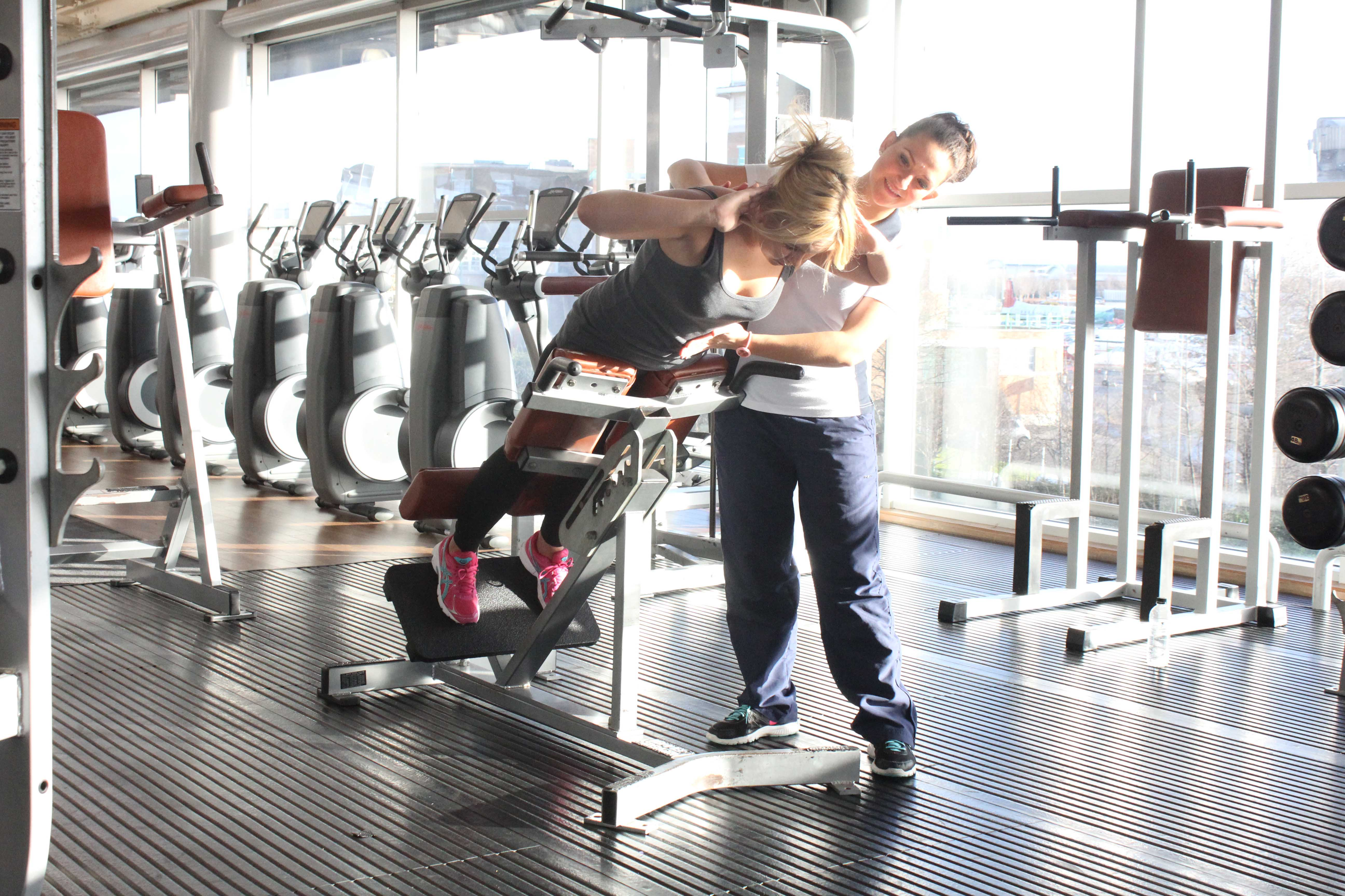 Progressive strengthening exercises for the lower back supervised by specialist MSK physiotherapist