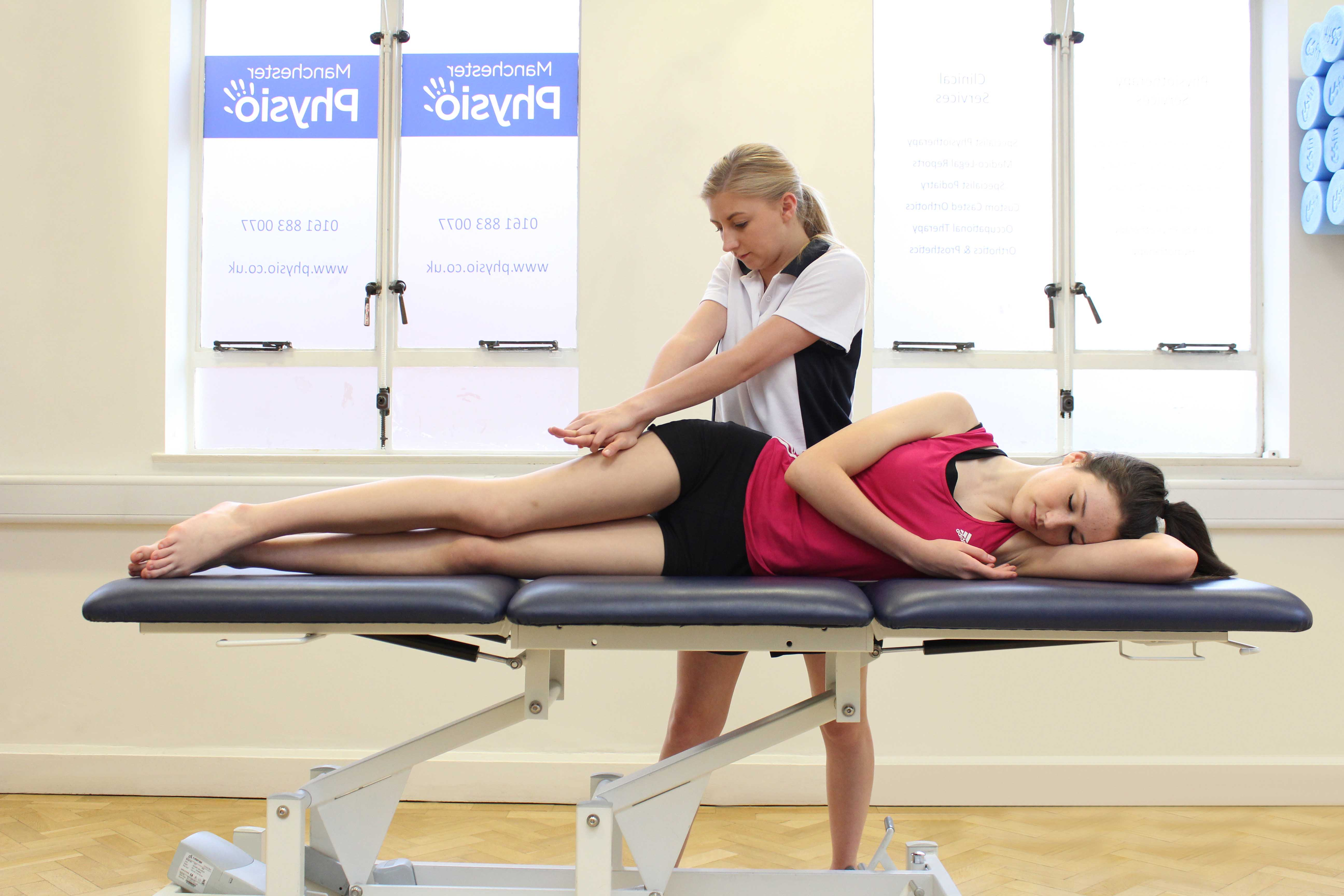 Soft tissue massage of the iliotibial band by an experienced MSK therapist
