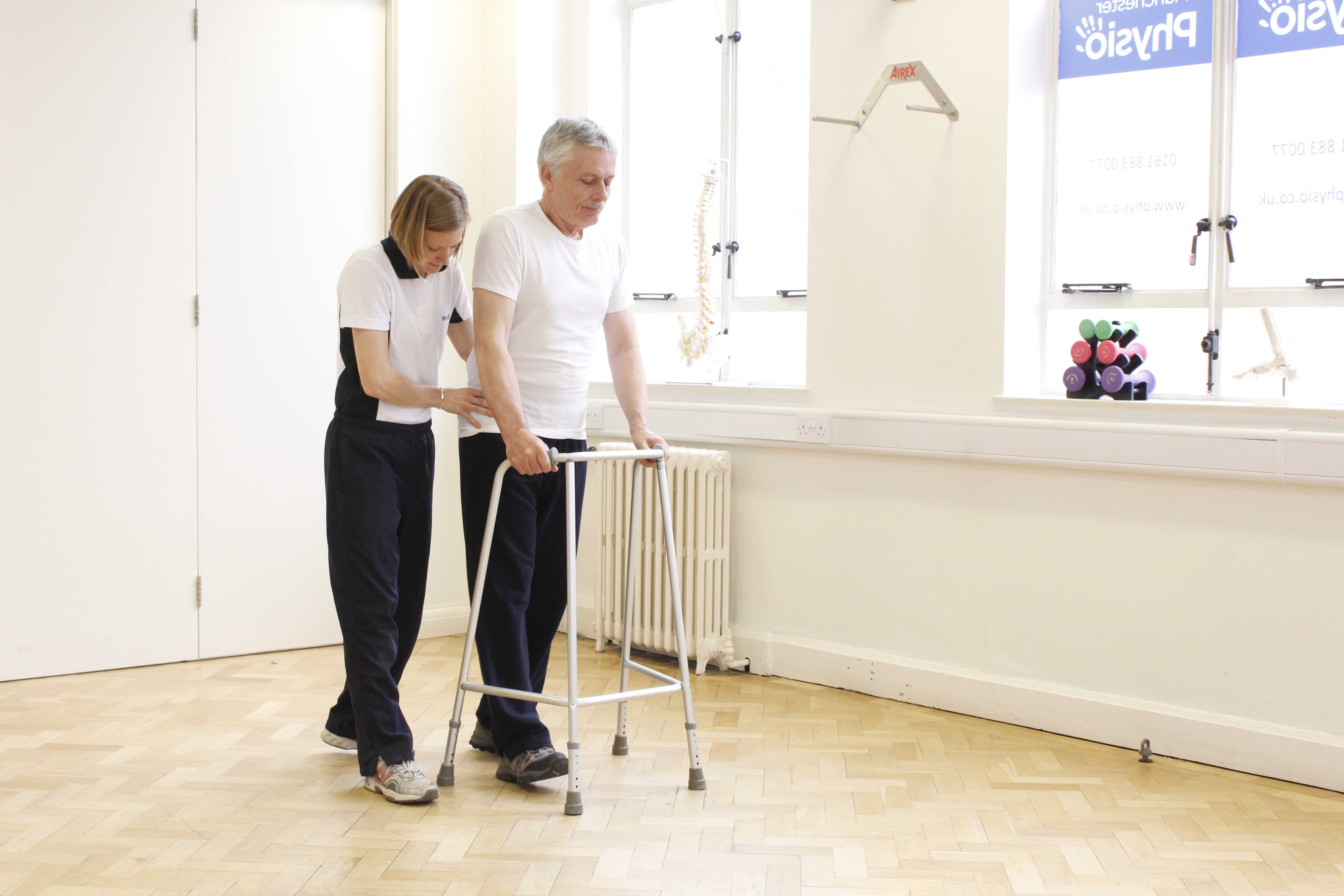 Mobility exercises using a walking frame under the close supervision of an experienced physiotherapist
