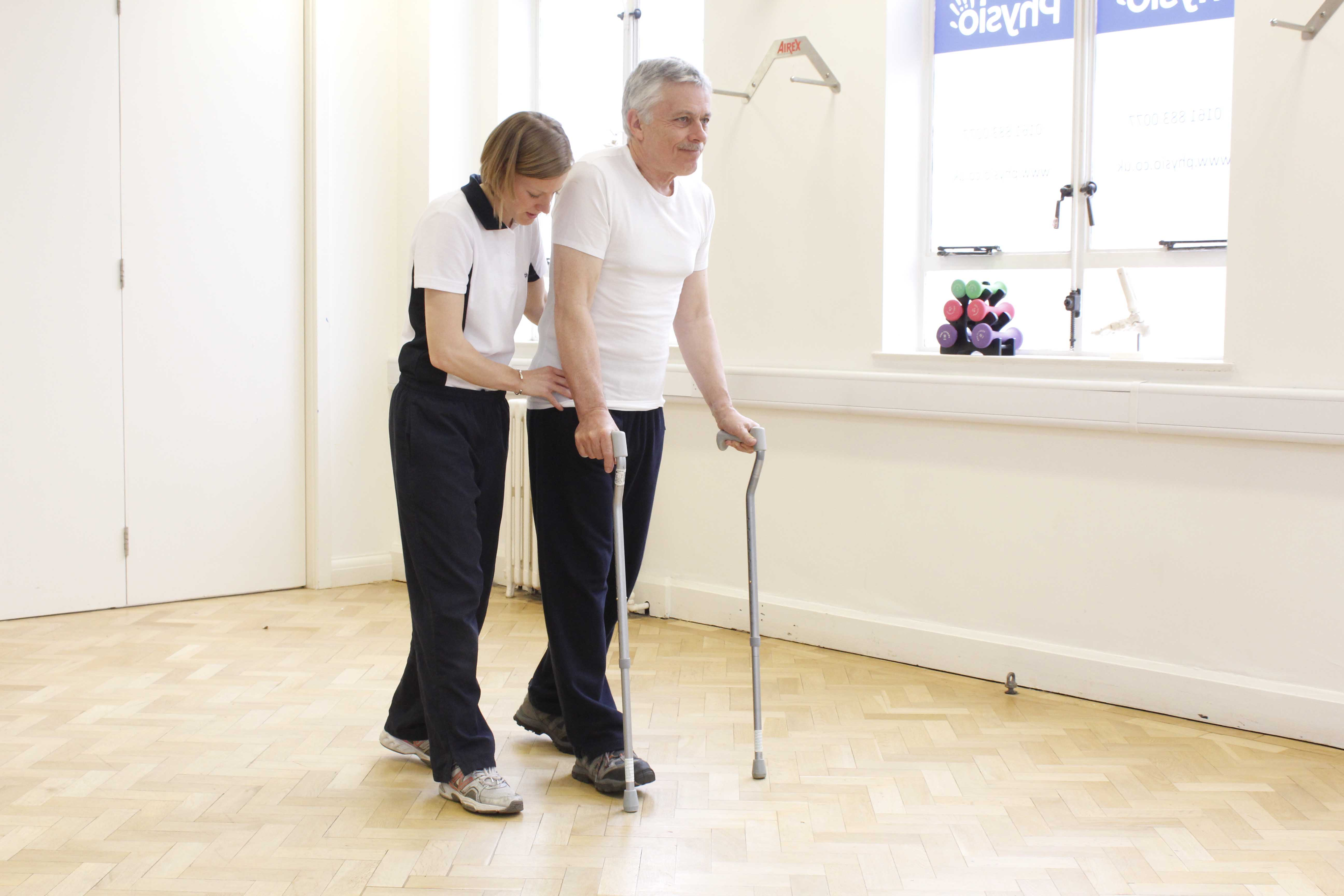 Mobility exercises using two walking sticks and close supervision of a physiotherapist