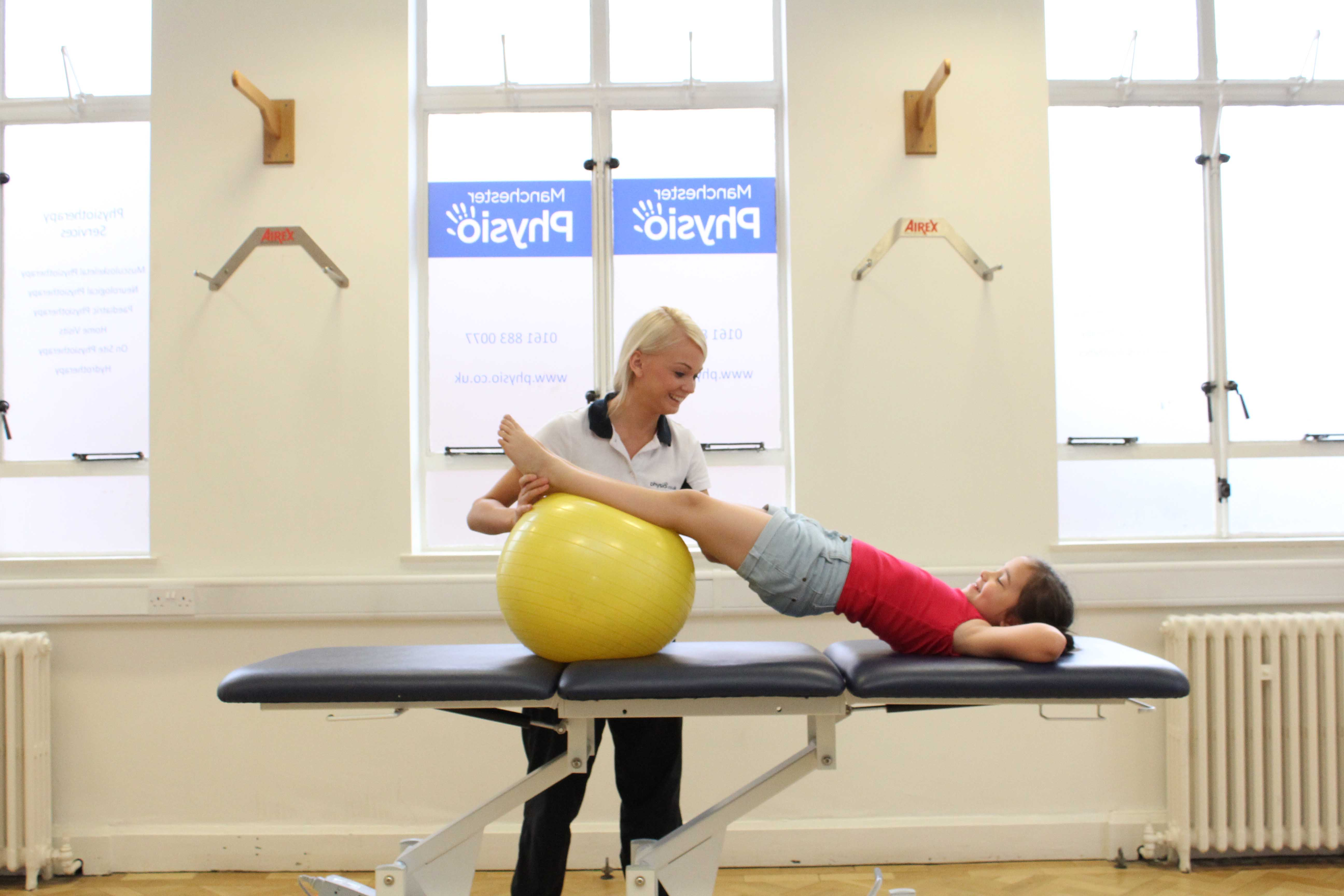 Core strength bridging exercise under close supervision of physiotherapist