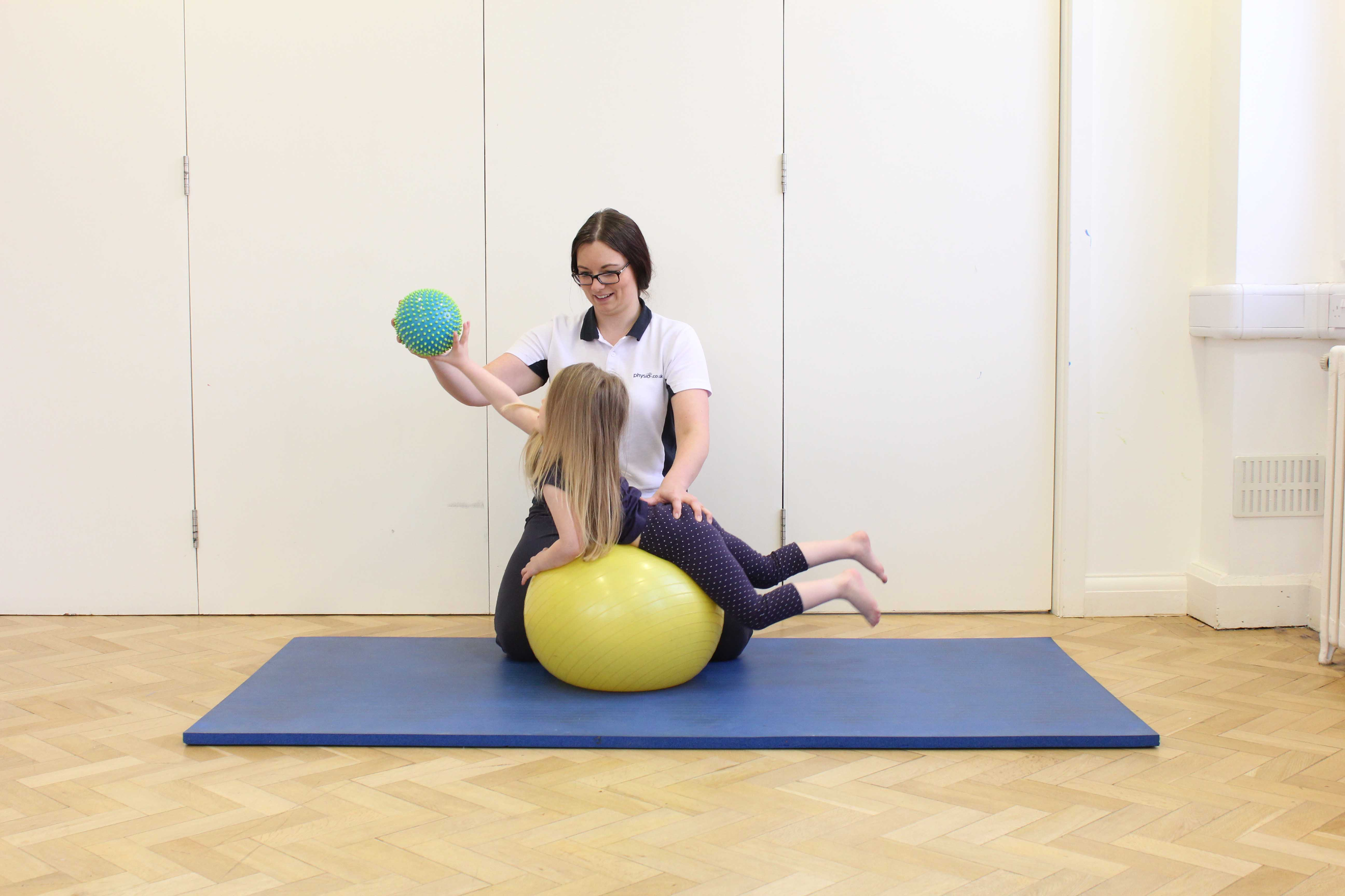 Active stretching exercises over a gym ball under close supervision of specialist paediatric physiotherapist