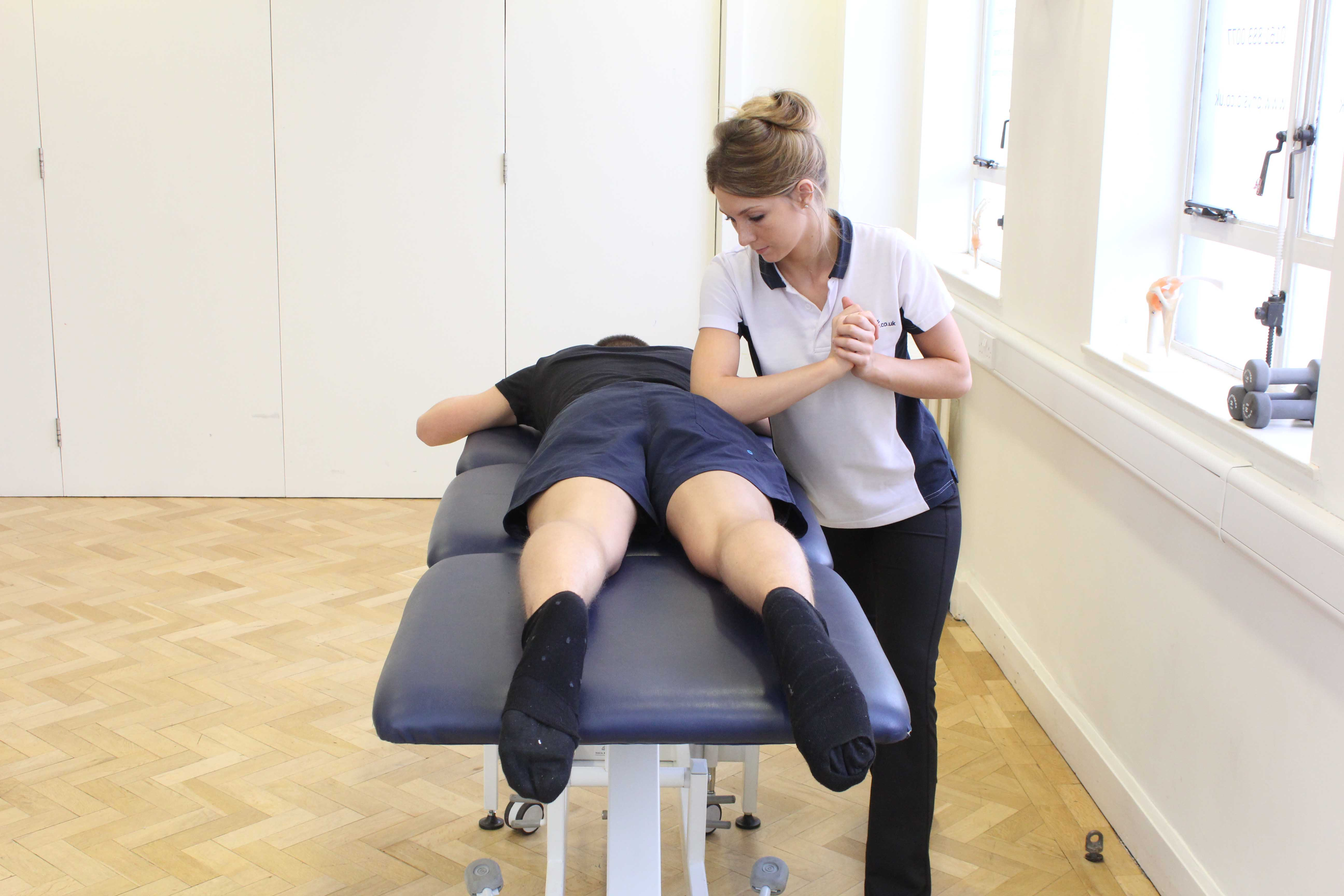 Deep tissue massage of the piriformis and gluteus maximus muscle by specialist therapist