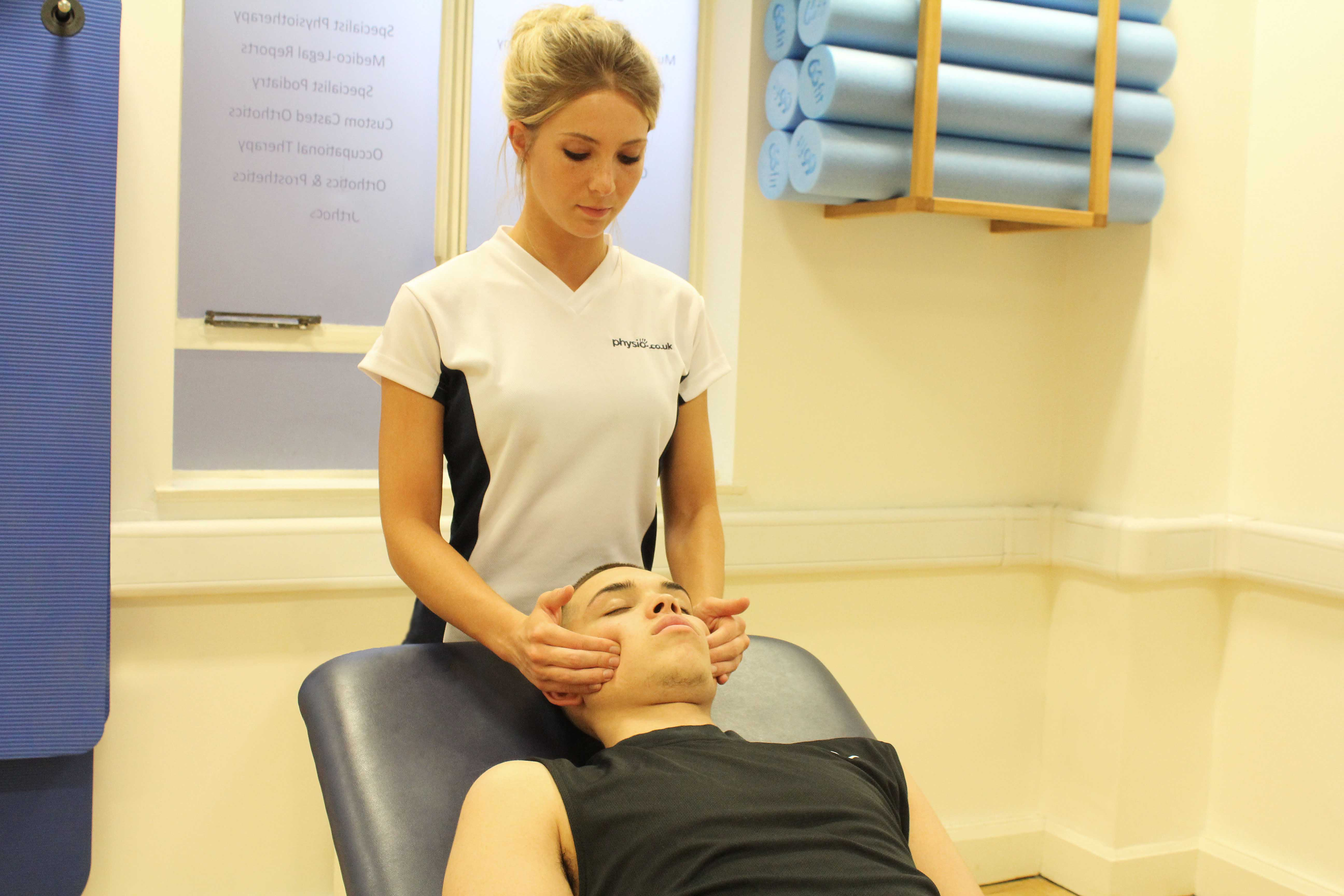 Soft tissue massage and mobilisation of the jaw to relieve stiffness and pain