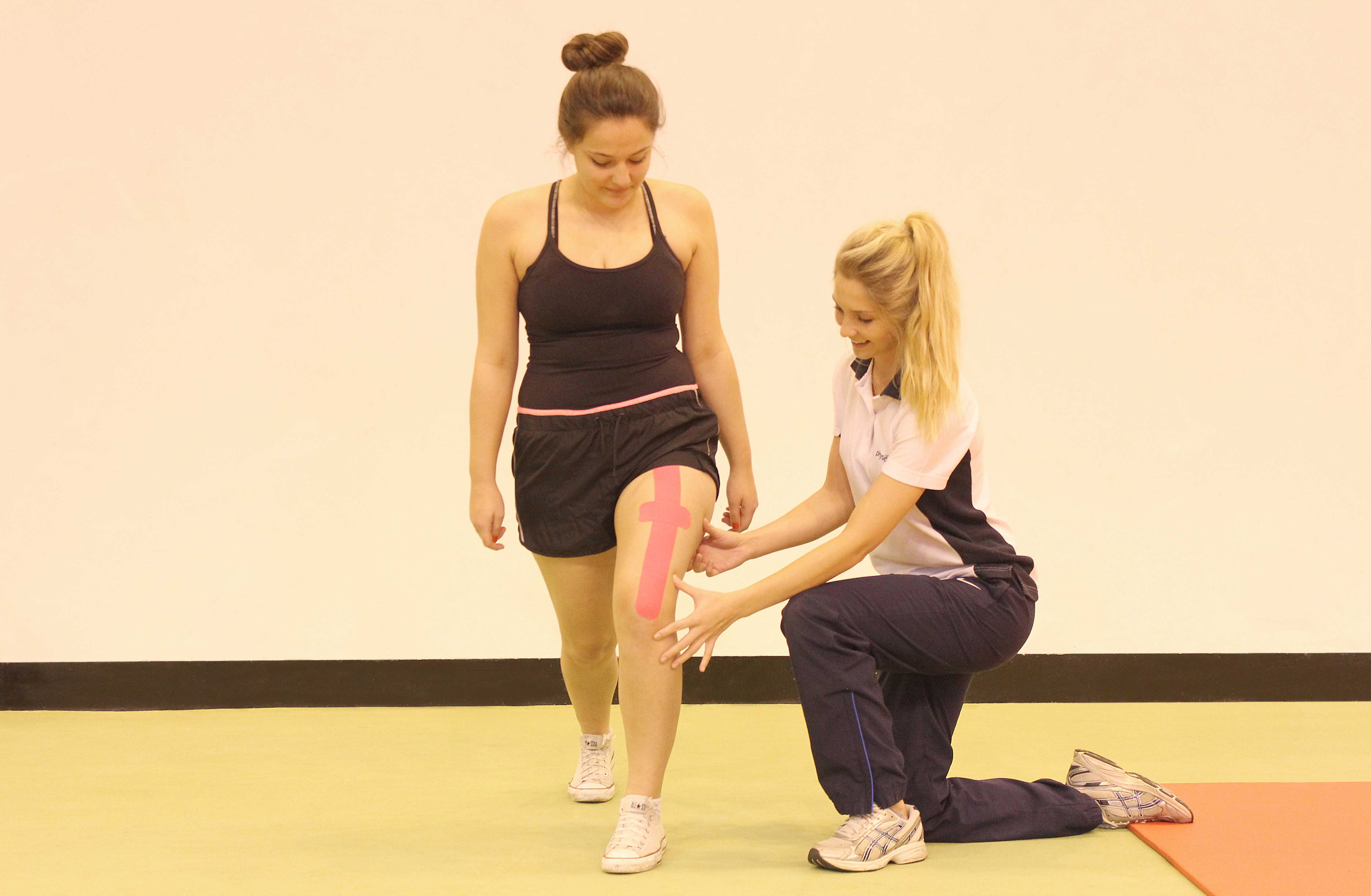 Progressive strengthening exercises, using supportive tape, supervised by therapist