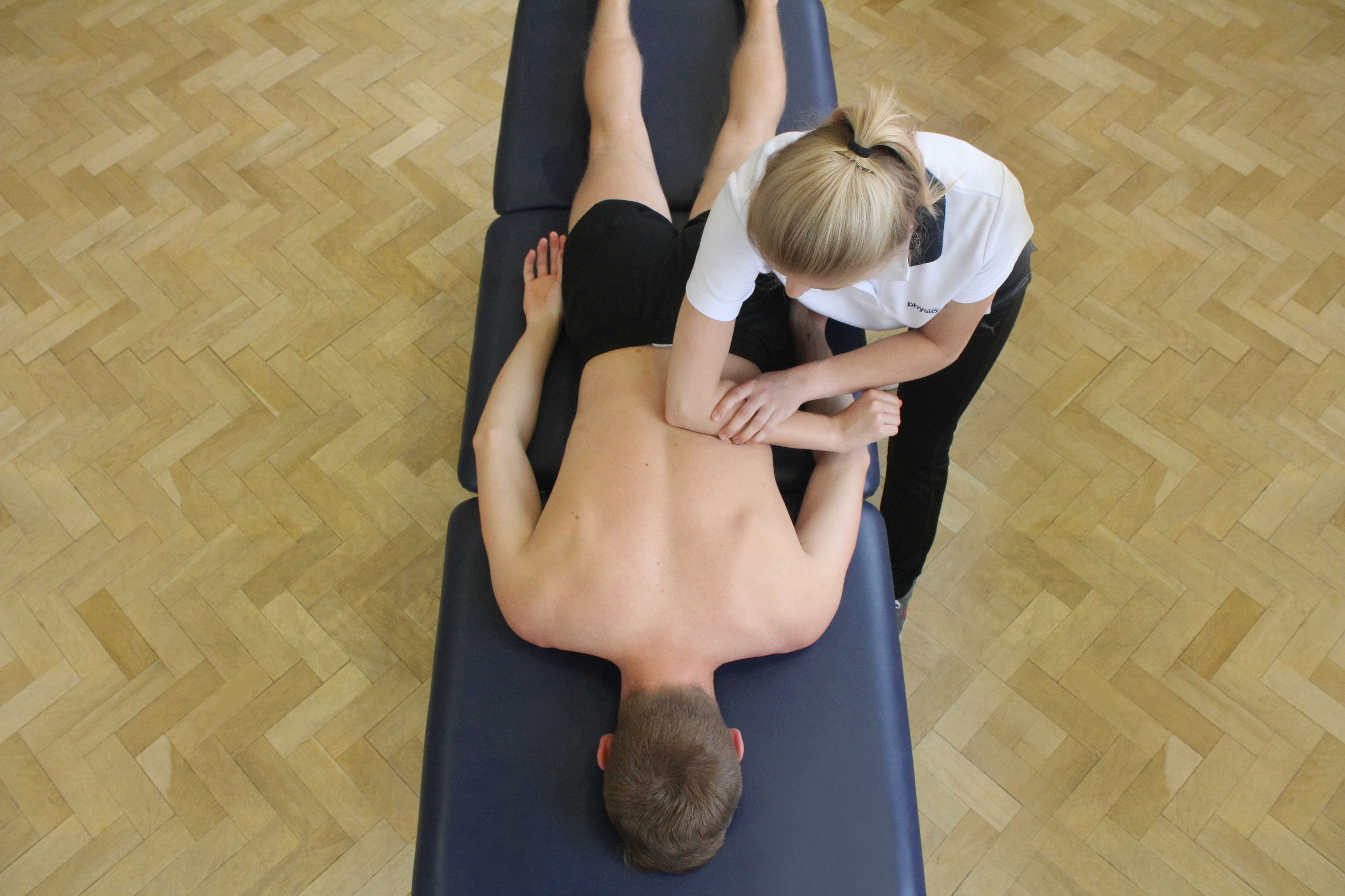Trigger point massage of the muscle and connective tissues in the upper back