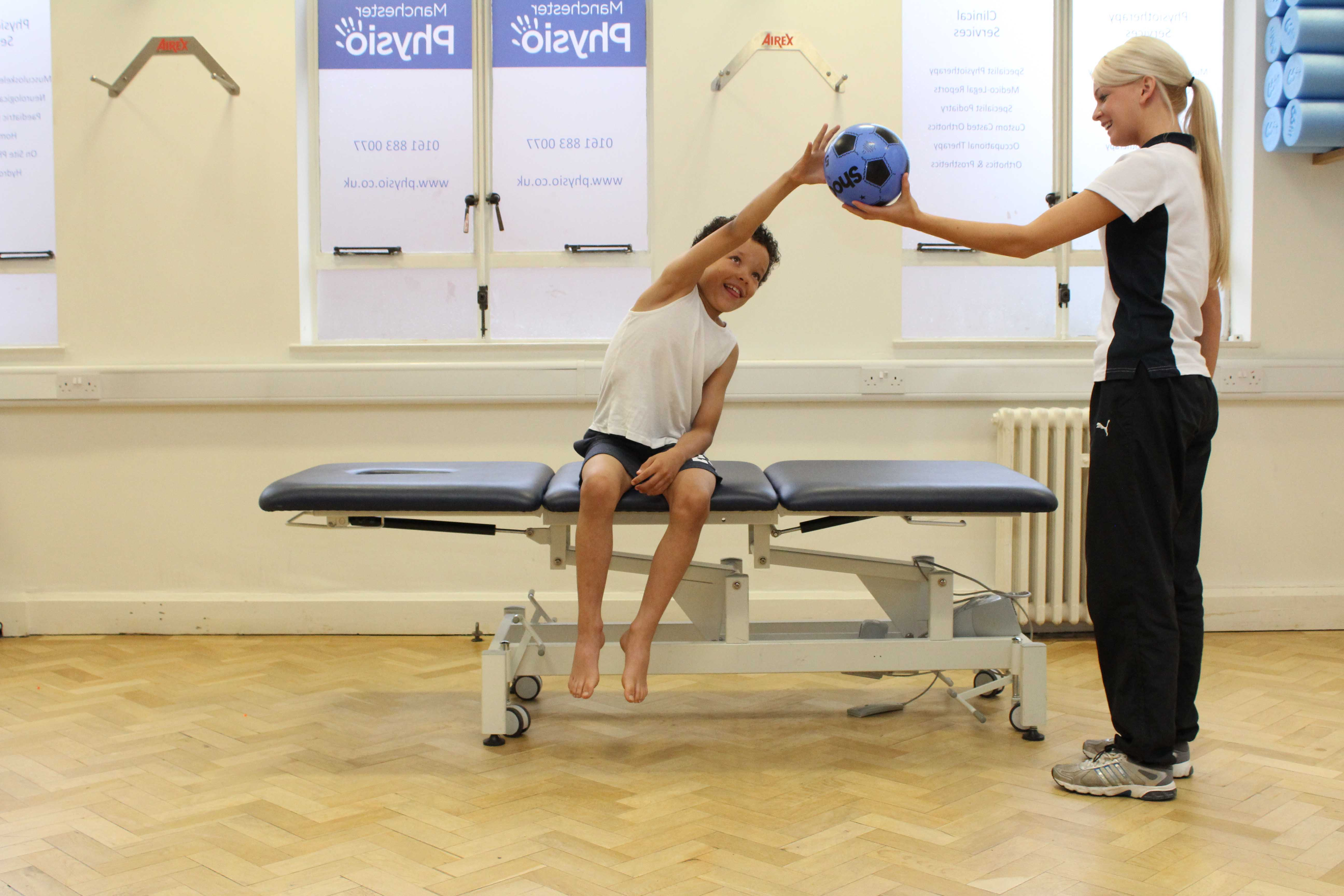 Proprioception and co-ordination exercises assisted by specialist paediatric physiotherapist