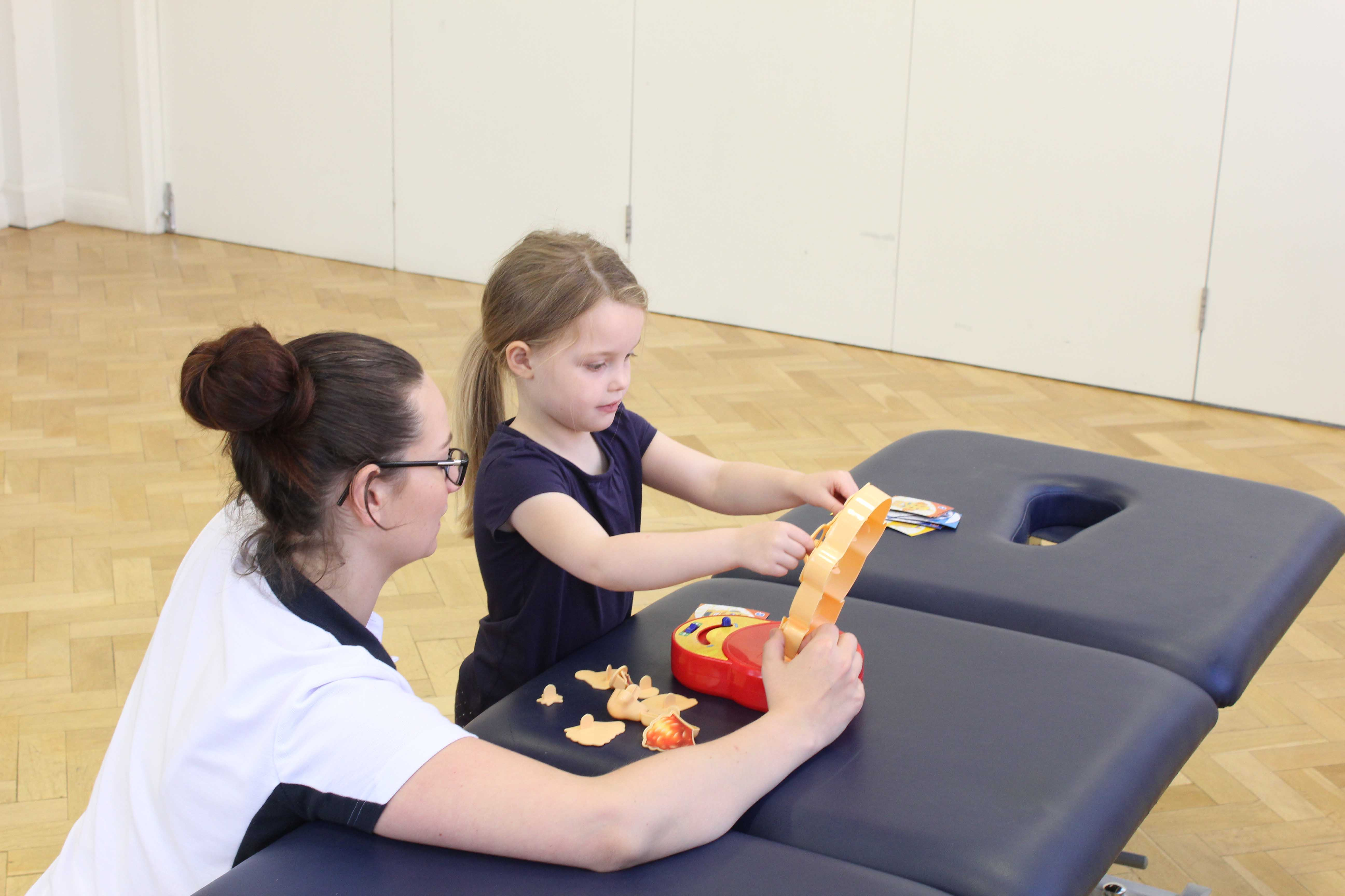 Fine motor skills and co-ordination exercises supervised by a paediatric physiotherapist